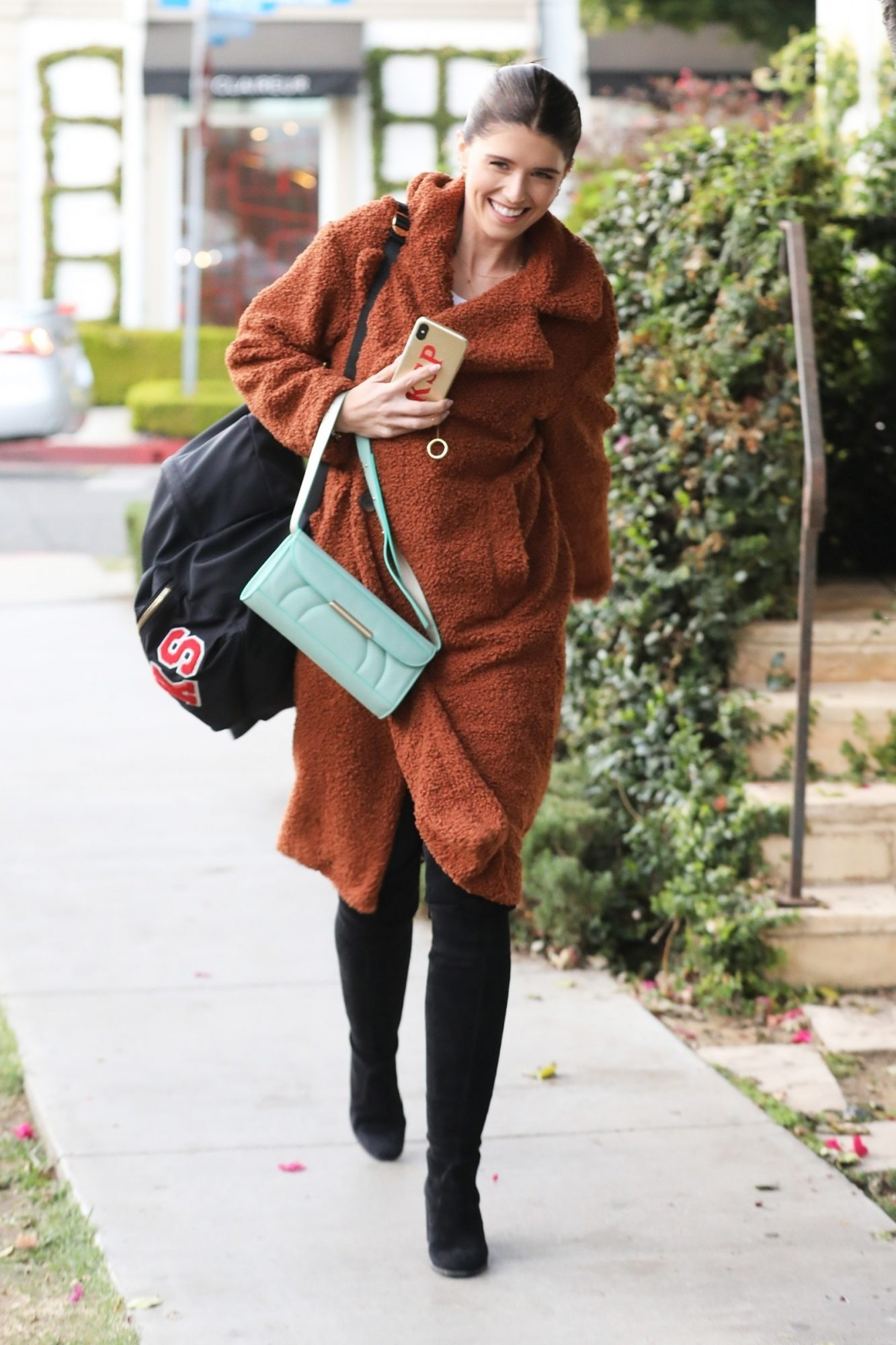 With fall weather officially in swing, I need a plush teddy coat likeKatherine Schwarzenegger's to stay warm - Sabrina                             Steal this star's cozy-yet-chic style with Lou & Grey's Teddy Coat, which comes in four fall-ready colors. Follow Schwarzenegger's lead andpair this statement jacket with all black for a sophisticated look.