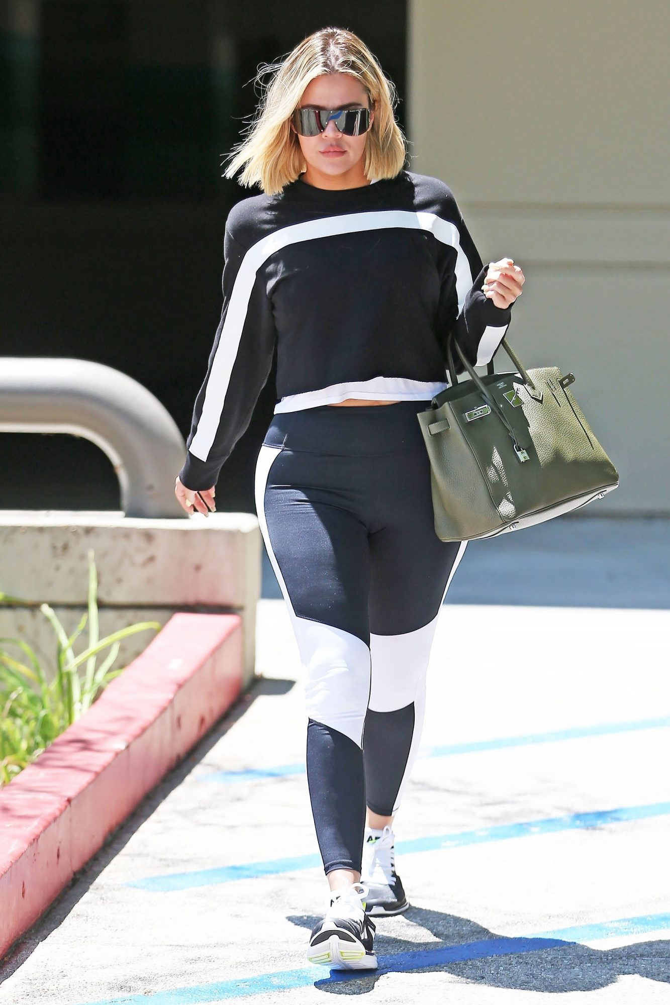 Khloé is my ultimate fitspiration. Where canI find these sneakersshe woreto workout?- Hailey                             KoKo's sporty black and whiteAPL sneakersare lightweight, breathable and perfect for an intense gym session.