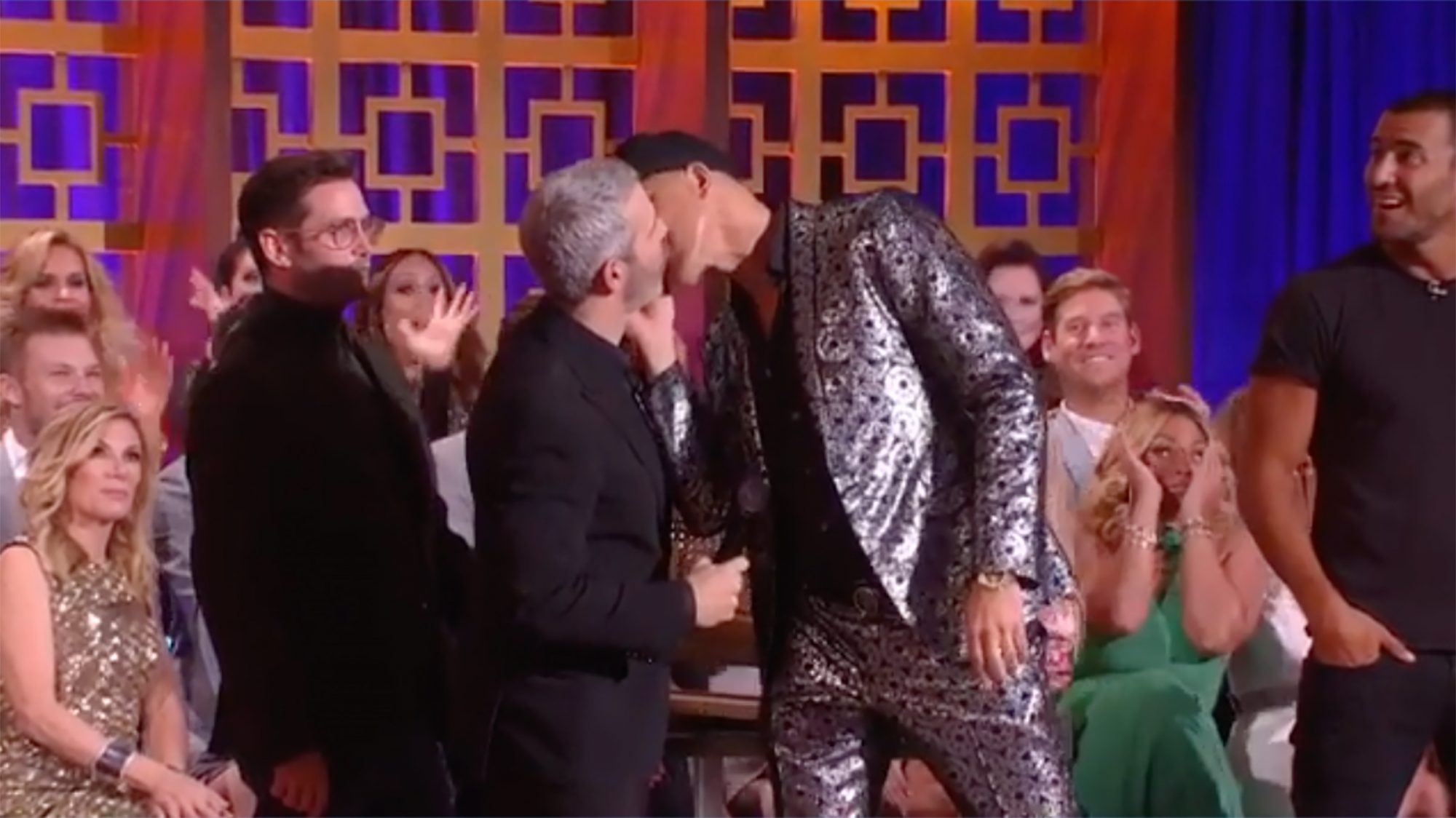 Frederick Eklund kisses Andy Cohen onstage at BravoCon