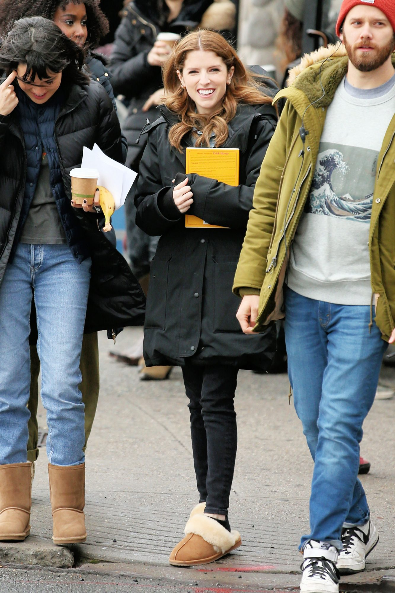Anna Kendrick is seen carrying a copy of 'Trick Mirror: Reflections on Self-Delusion' by Jia Tolentino on the set of 'Love Life' filming in Brooklyn, New York
