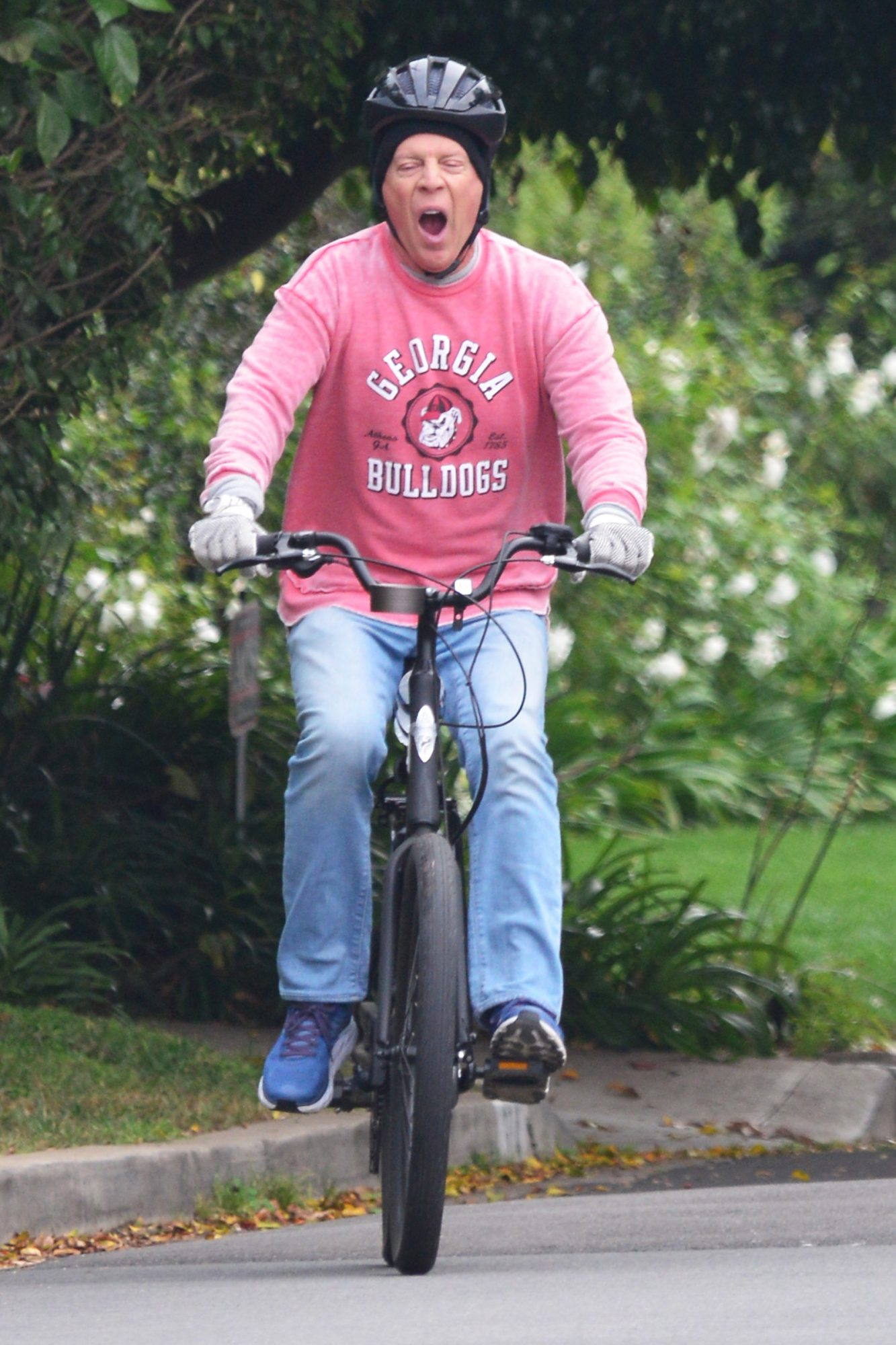 Bruce Willis looks like he is in need of some sleep as he lets out a huge yawn while on an early morning bike ride on his $2k Electric Go Bike through the streets of Brentwood, Ca