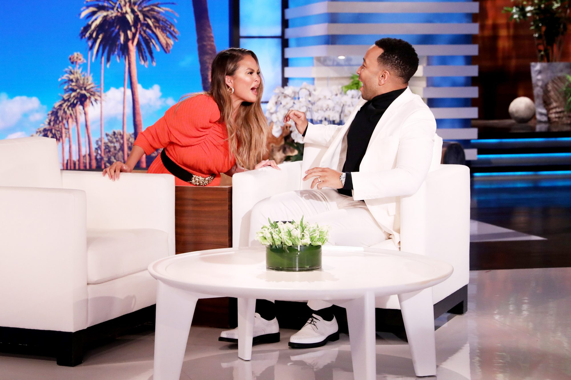 "Newly crowned People magazine's Sexiest Man Alive John Legend fills in as guest host on ""The Ellen DeGeneres Show"" airing Friday, November 15th, and shares his thoughts about the honor. After John shows a clip revealing Ellen as his original ""co-star"" in his ""All of Me"" music video, his wife, Chrissy Teigen, hilariously jumps out of the side table and scares her husband."