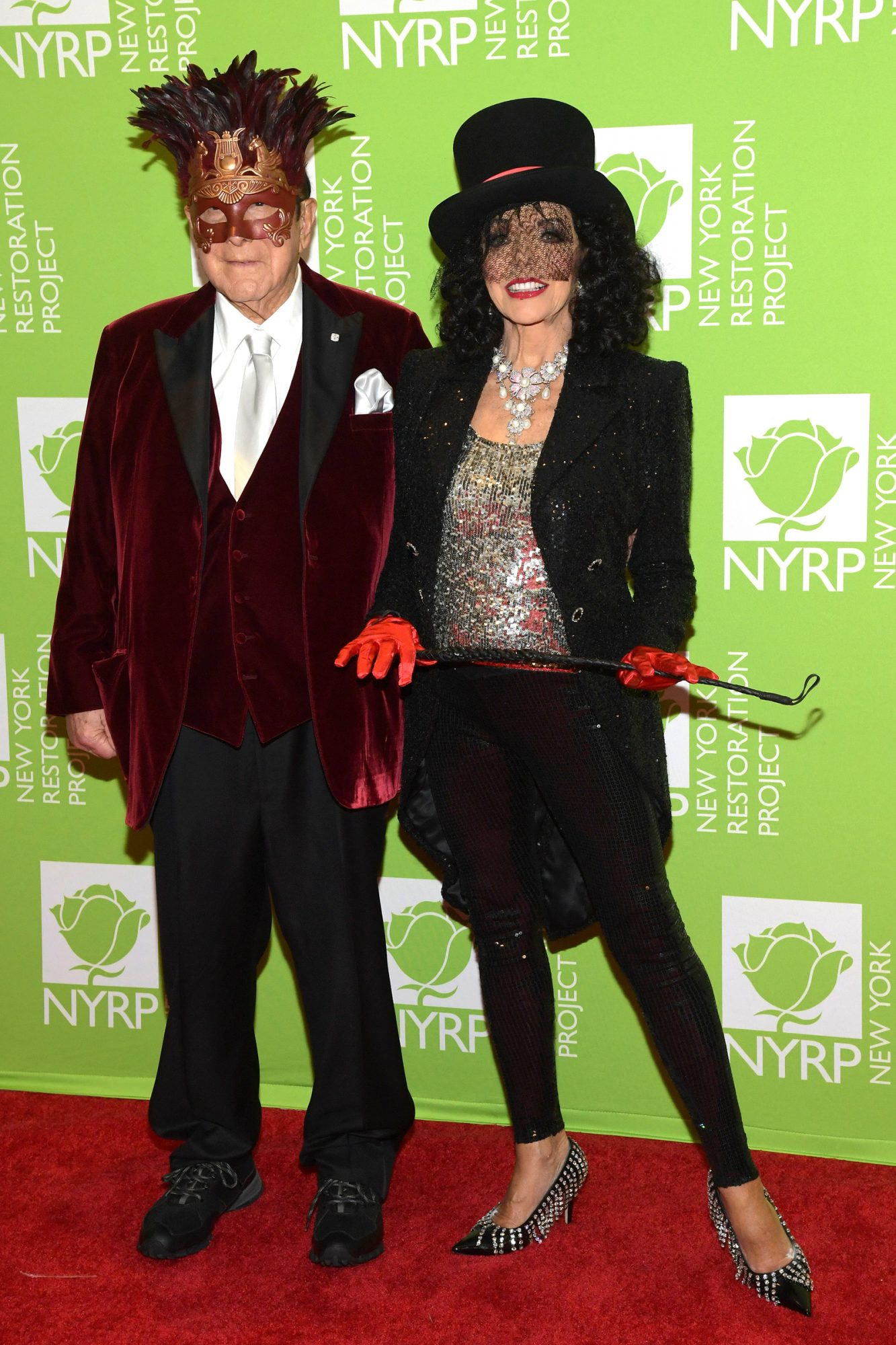 Clive Davis and Joan Collins