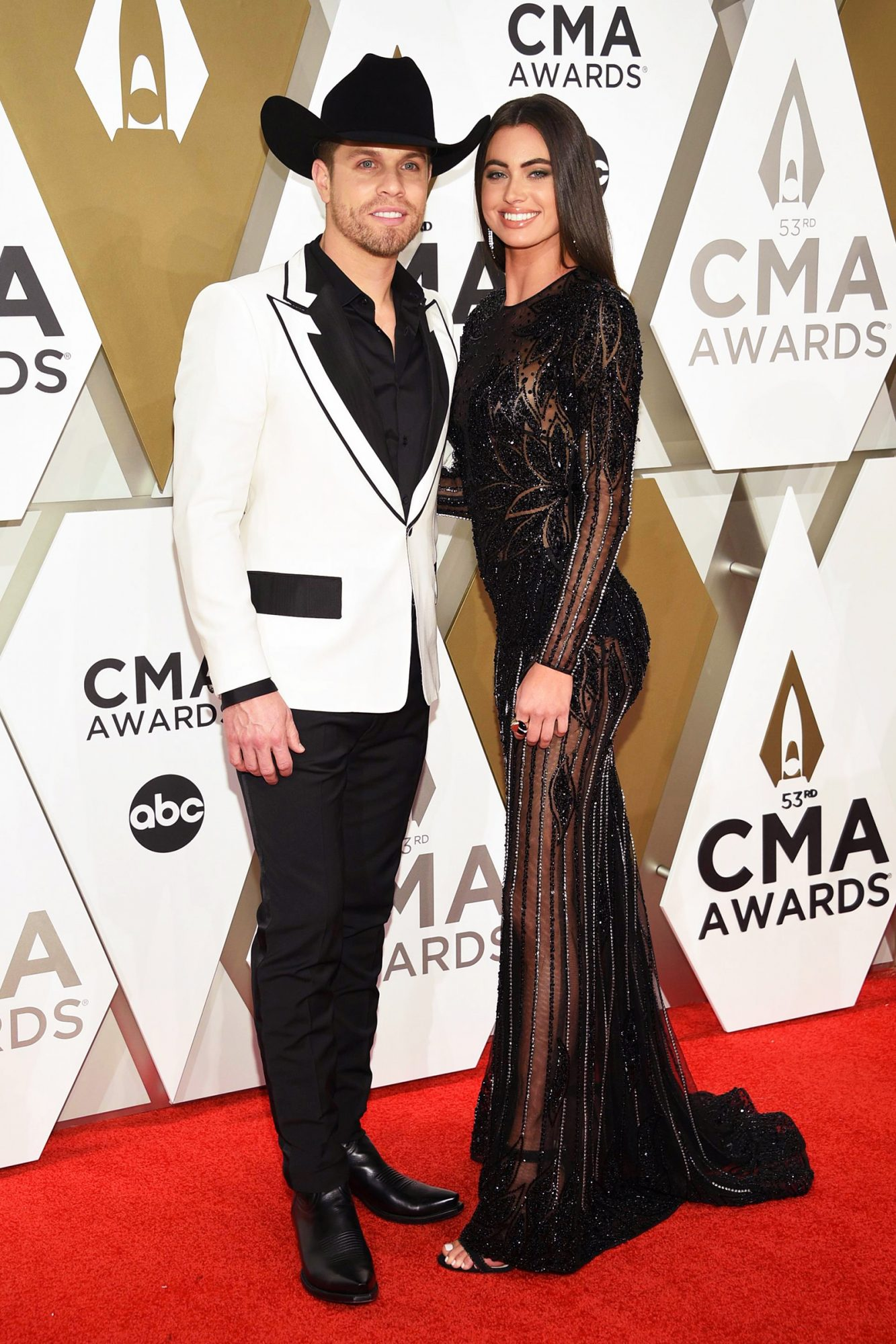 Dustin Lynch, left, and Kelli Seymour arrive at the 53rd annual CMA Awards at Bridgestone Arena, in Nashville, Tenn 53rd Annual CMA Awards