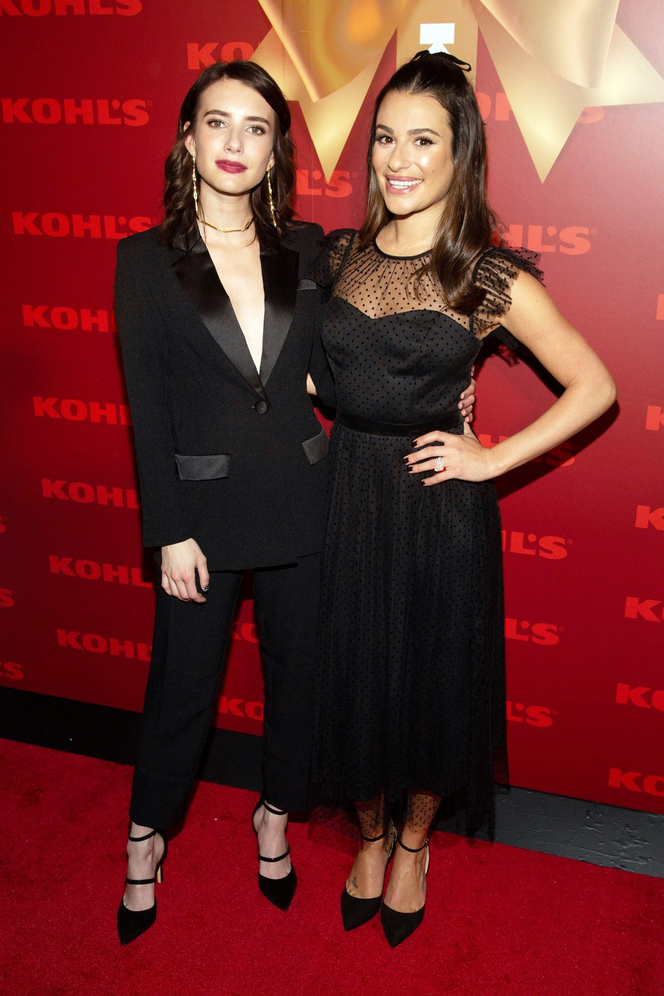 """Emma Roberts, left, and Lea Michele, right, attend Kohl's """"New Gifts at Every Turn"""" holiday shopping event, in New York"""
