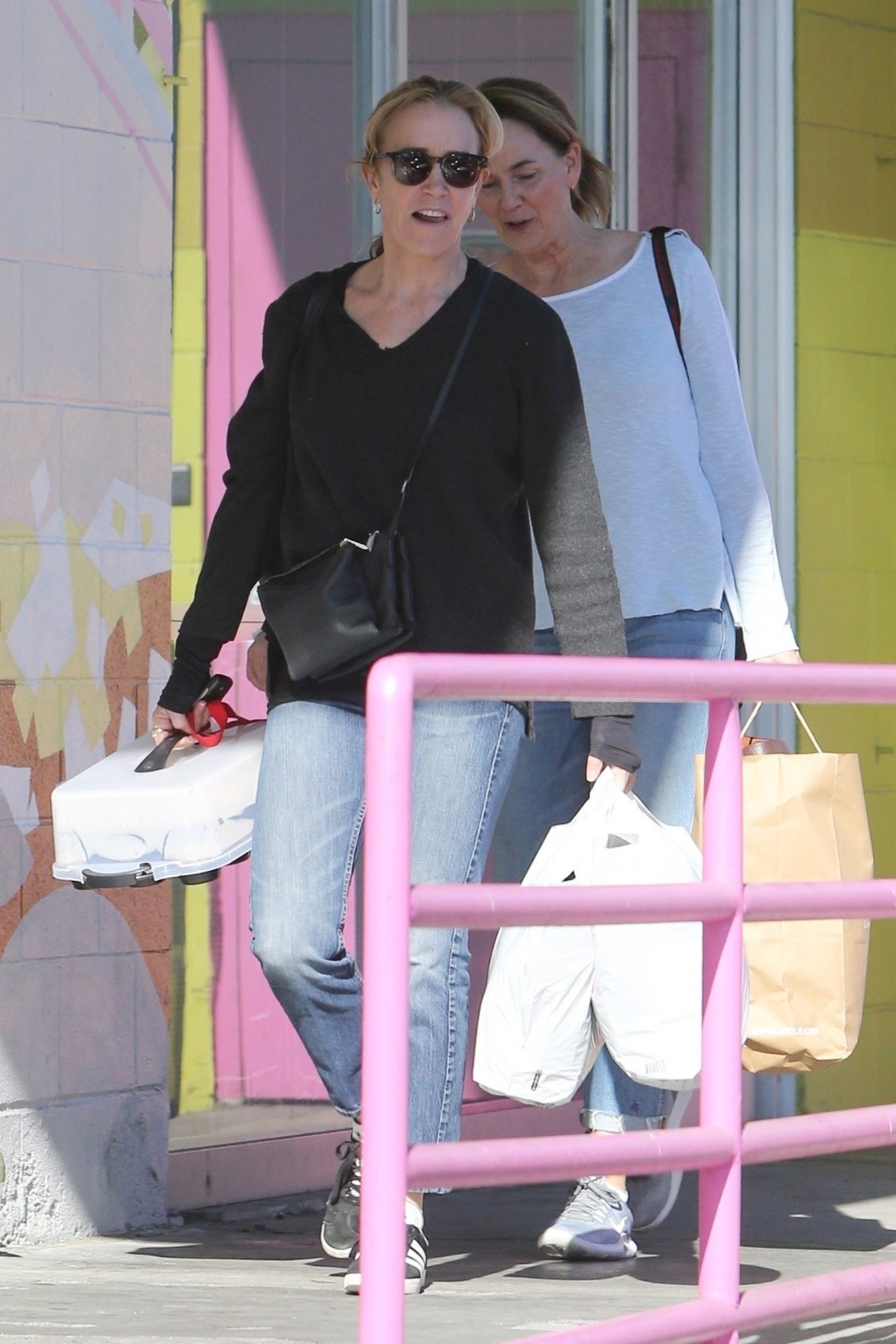 Felicity Huffman brings some cupcake treats as she arrives for her community service at The Teen Project. The actress was sentenced to 250 hours of community service as part of her sentence for her involvement in the college admissions scandal.