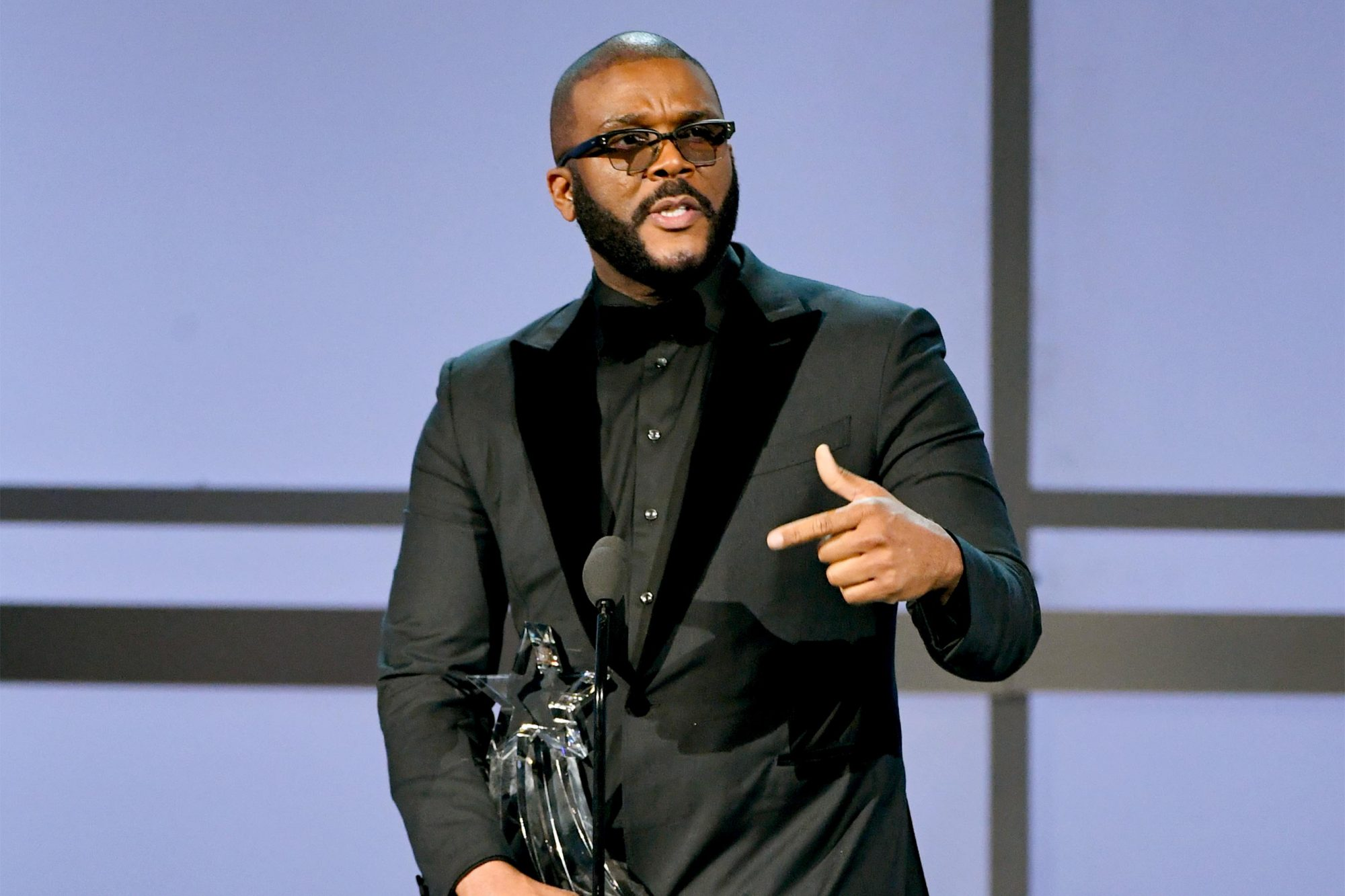 LOS ANGELES, CALIFORNIA - JUNE 23: Tyler Perry accepts the Ultimate Icon Award onstage at the 2019 BET Awards on June 23, 2019 in Los Angeles, California. (Photo by Kevin Winter/Getty Images)