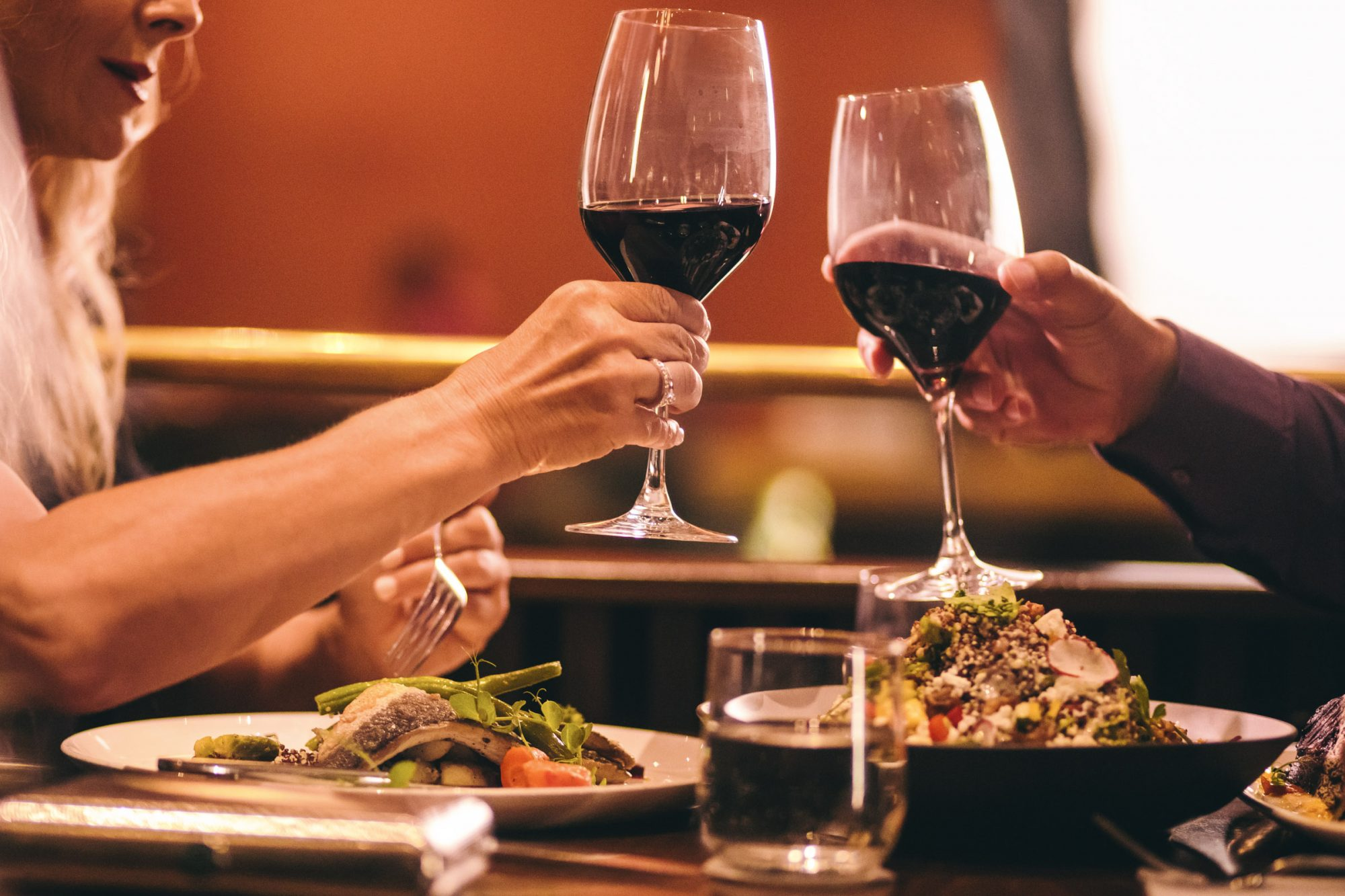 toasting with wine at gourmet restaurant