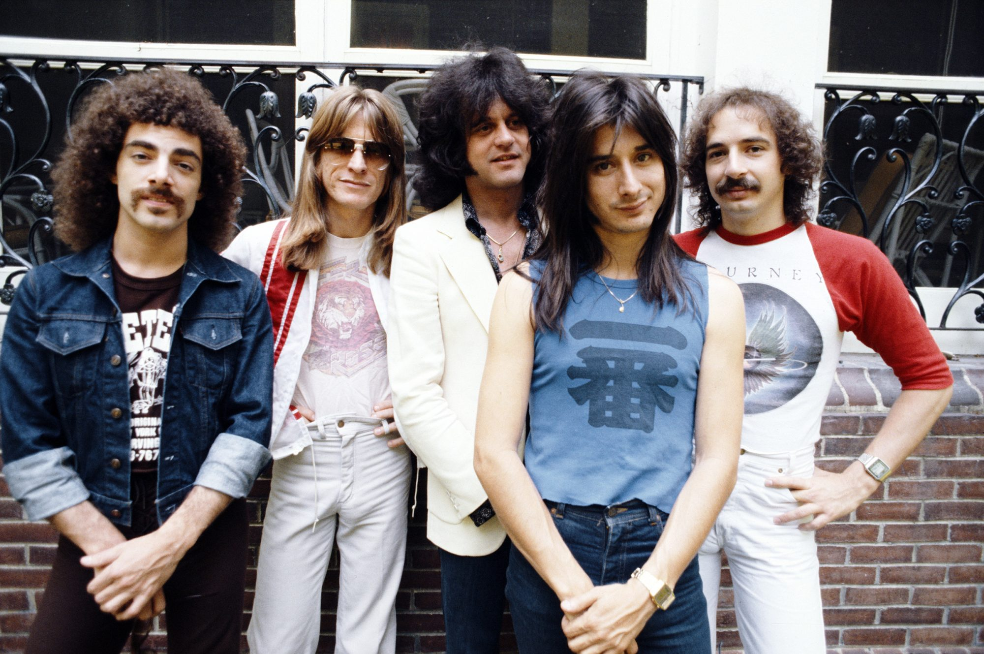 American rock group Journey, New York, June 1979. Left to right: guitarist Neal Schon, bassist Ross Valory, keyboard player Gregg Rolie, singer Steve Perry, and drummer Steve Smith. (Photo by Michael Putland/Getty Images)