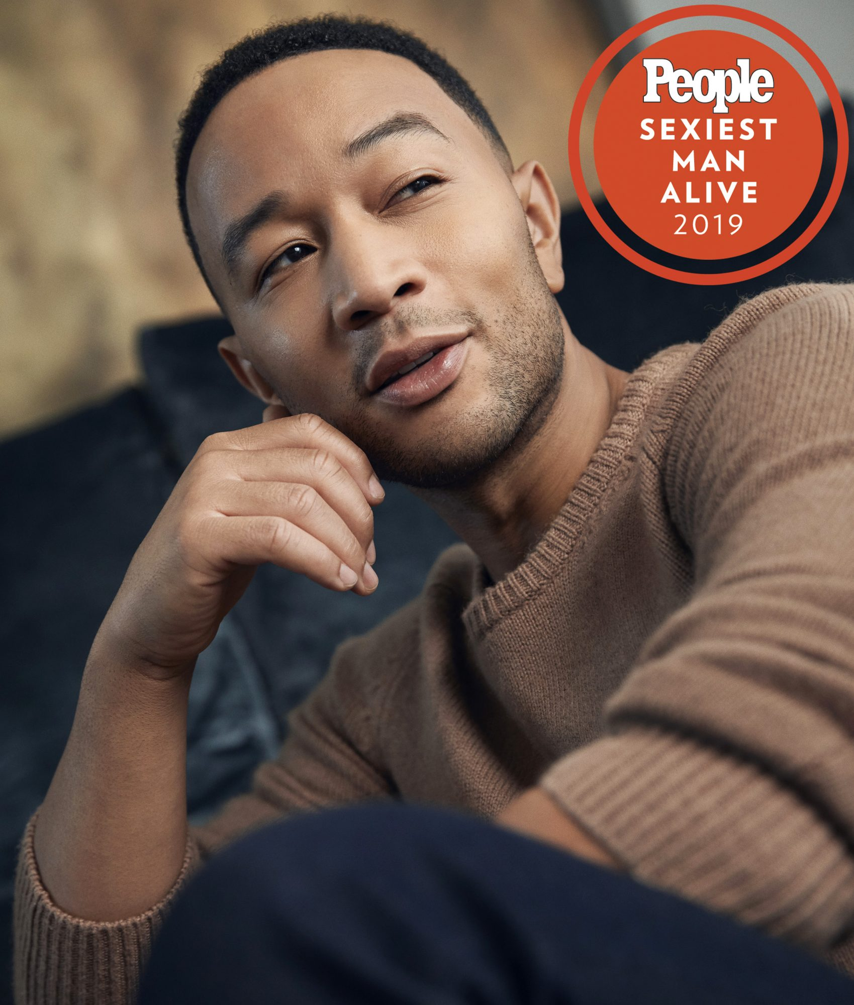 John legend in a tan sweater