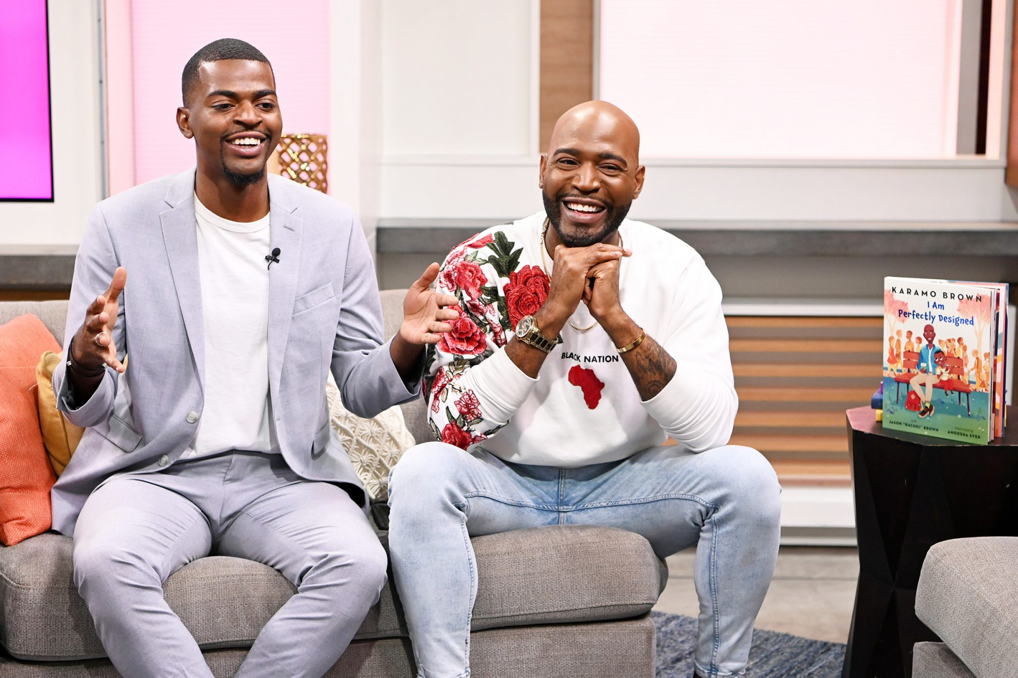 """Karamo Brown (R) and son Jason Brown visit PeopleNow to promote their new book """"I am Perfectly Designed"""" at PeopleTV Studios on November 06, 2019 in New York"""