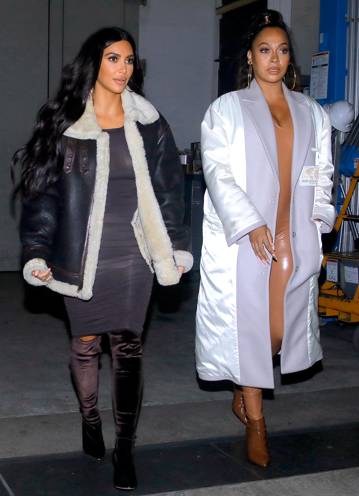 Kim Kardashian and La La Anthony show off their style as they exit the Kanye West concert