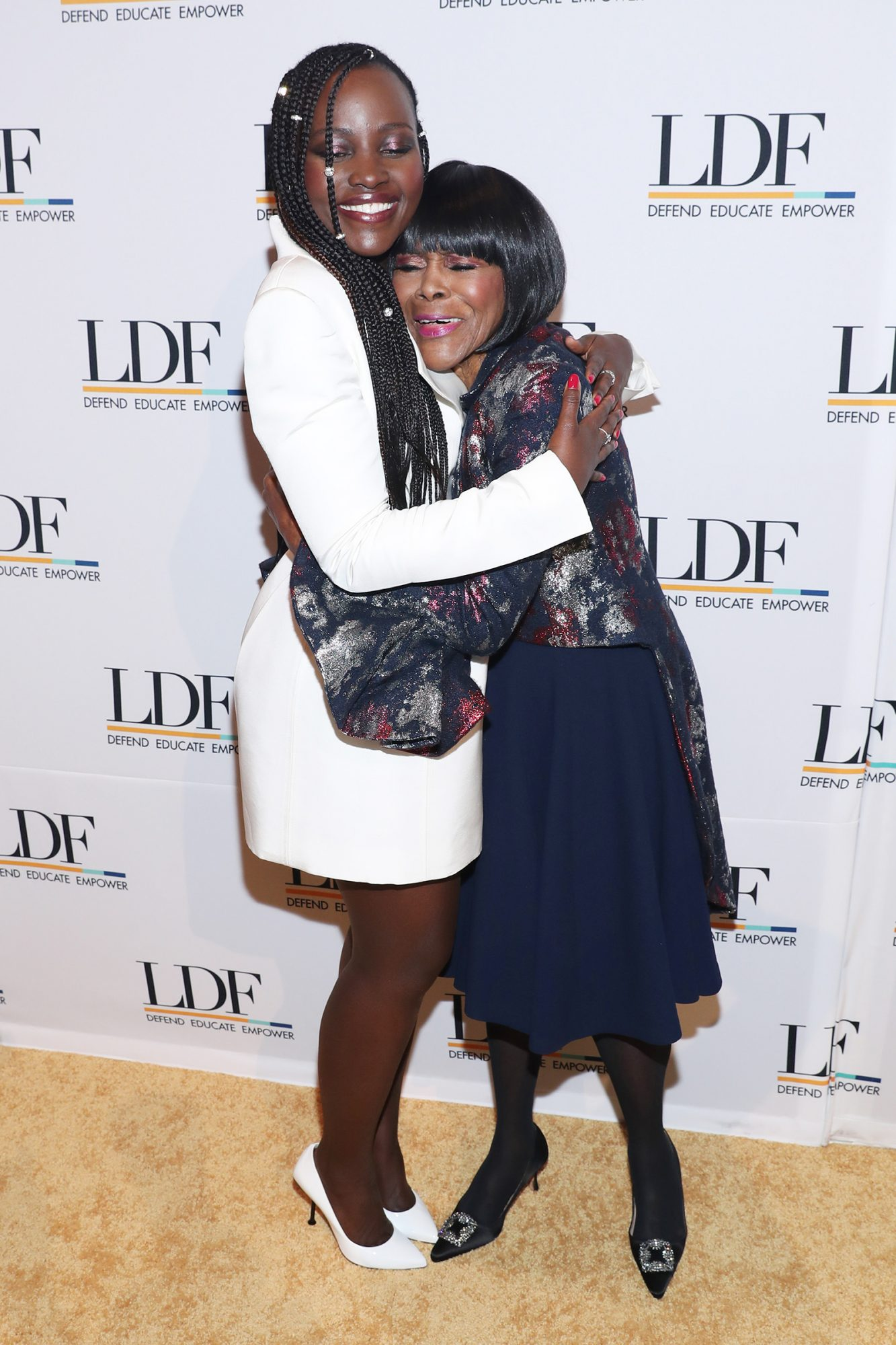 Lupita Nyong'o and Cicely Tyson embrace at the NAACP LDF 33rd National Equal Justice Awards Dinner at Cipriani 42nd Street on November 07, 2019 in New York City