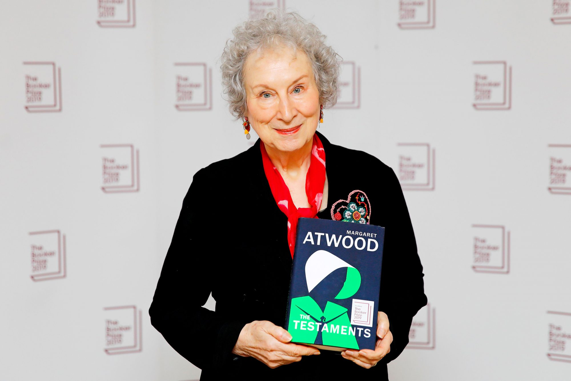 Margaret Atwood poses with her book 'The Testaments' during the photo call for the authors shortlisted for the 2019 Booker Prize for Fiction at Southbank Centre in London on October 13, 2019