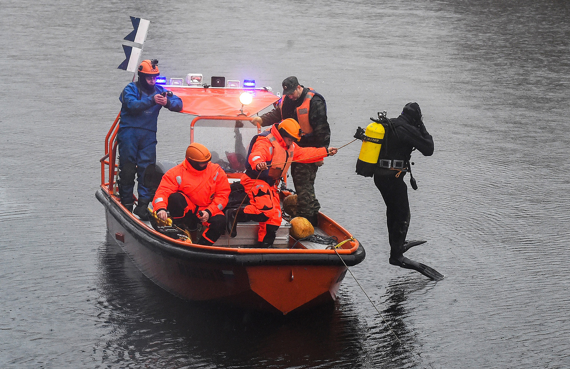 Russian Emergency rescuers and police investigators conduct searches on the Moika River, in Saint Petersburg