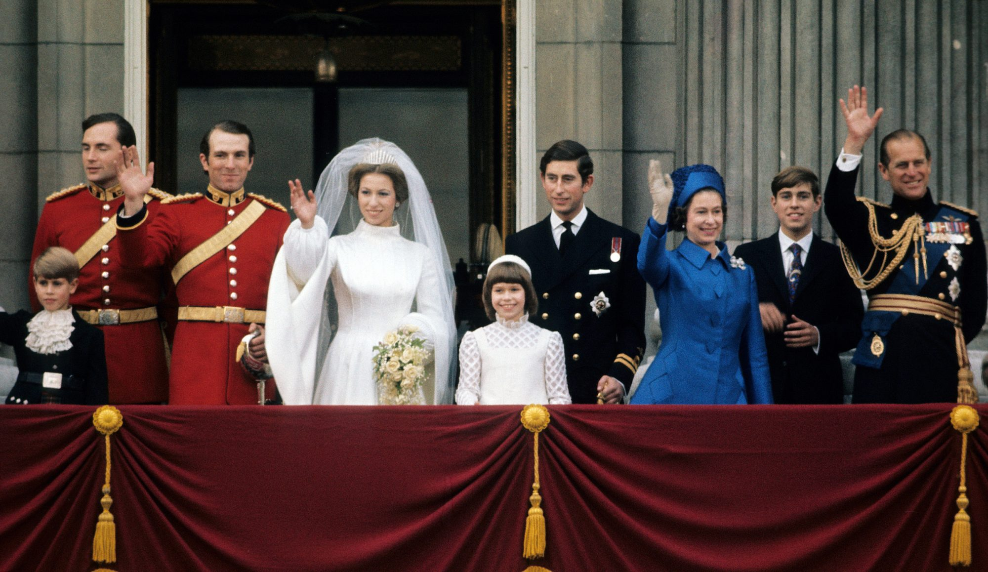 Princess Anne, Princess Royal and Mark Phillips (3rd from left) wave from the balcony of Buckingham Palace following their wedding with Prince Edward, Earl of Wessex (L), Prince Charles, Prince of Wales (4th from right), Queen Elizabeth II (3rd from right), Prince Andrew, Duke of York (2nd right) and Prince Philip, Duke of Edinburgh on November 14, 1973 in London, England.