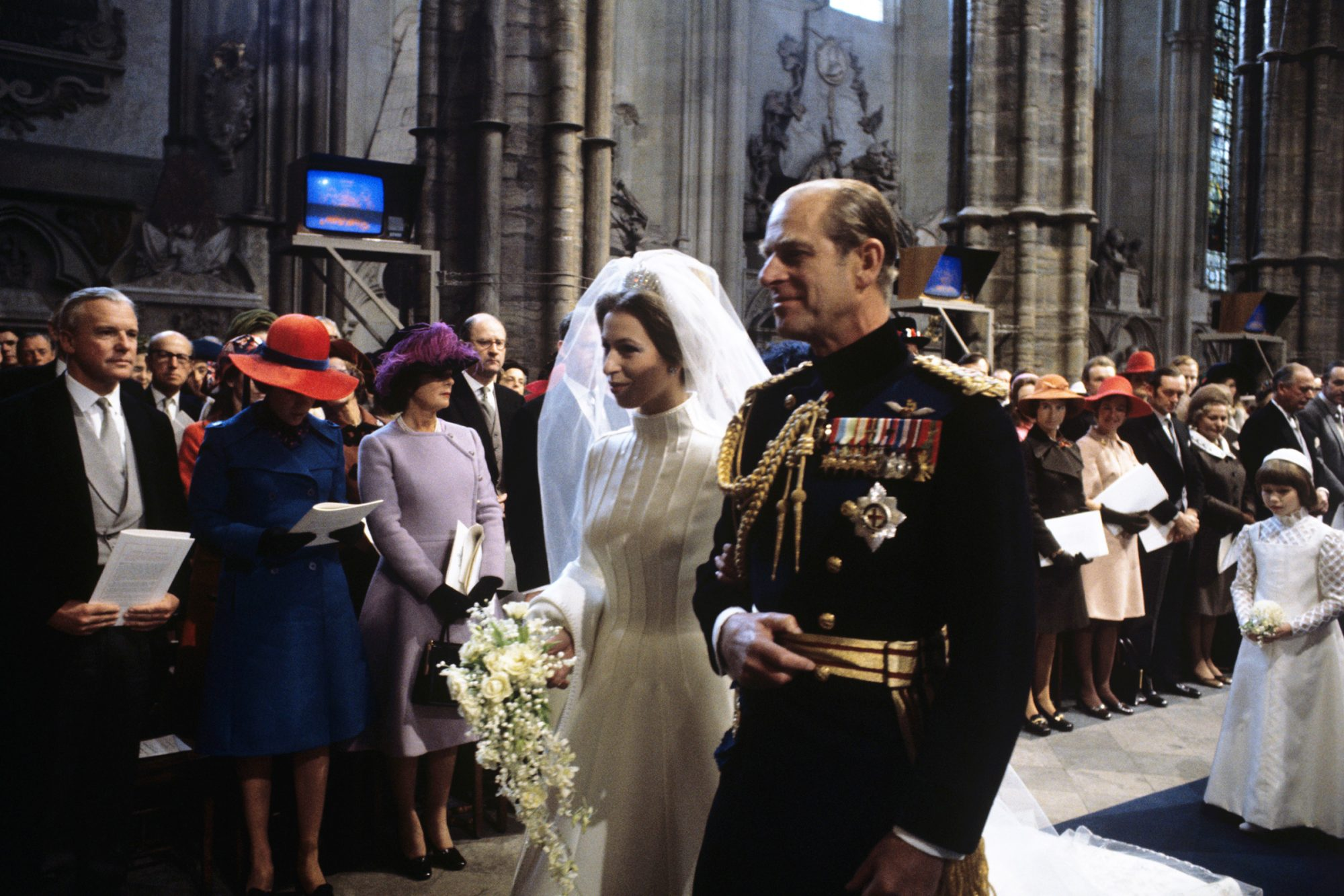 Princess Anne and her father, Prince Philip, Duke of Edinburgh, walk up the aisle during the wedding ceremony in Westminster Abbey