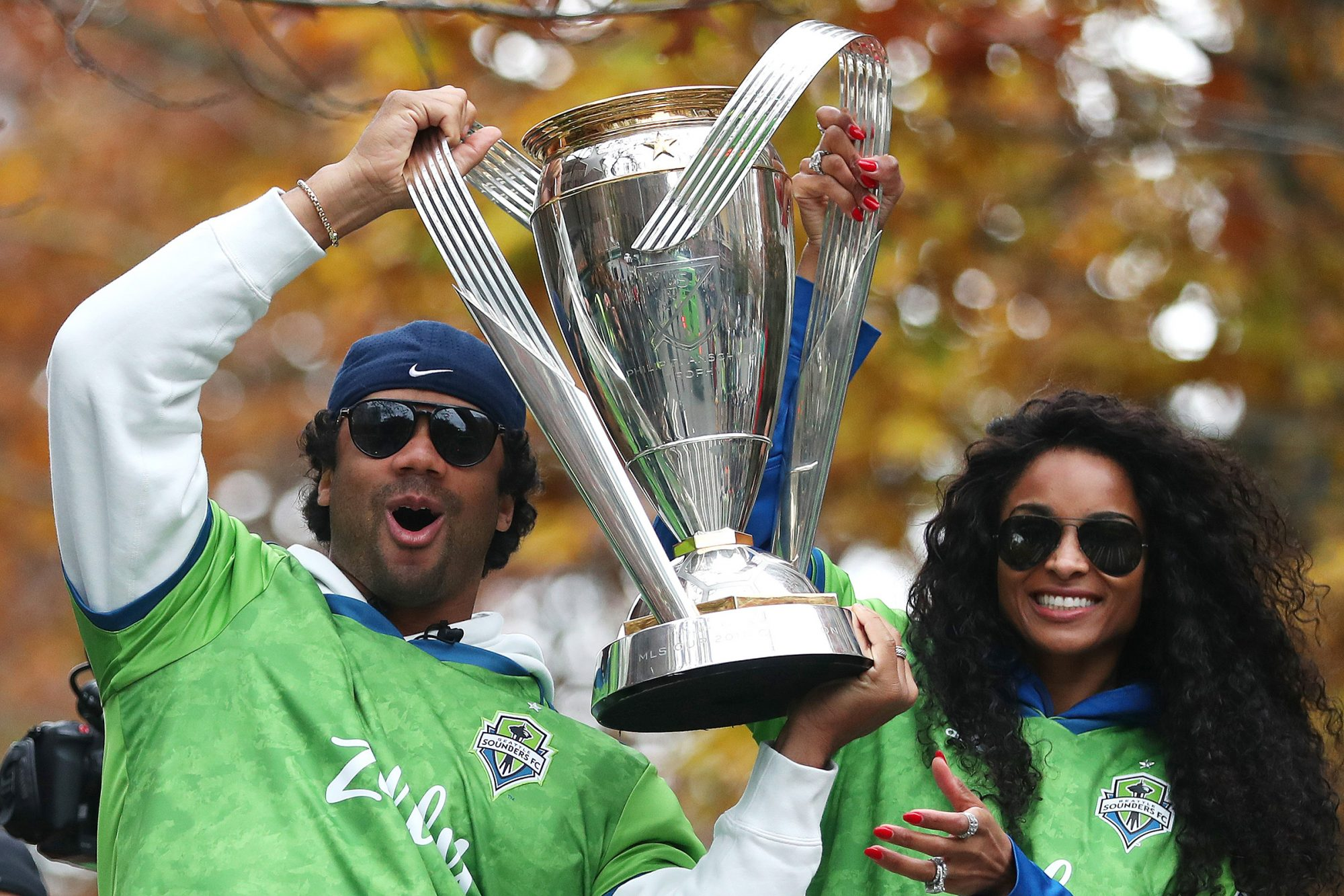 Seattle Sounders part owners Russell Wilson and Ciara show their support for the team during their MLS Cup victory parade on November 12, 2019 in Seattle