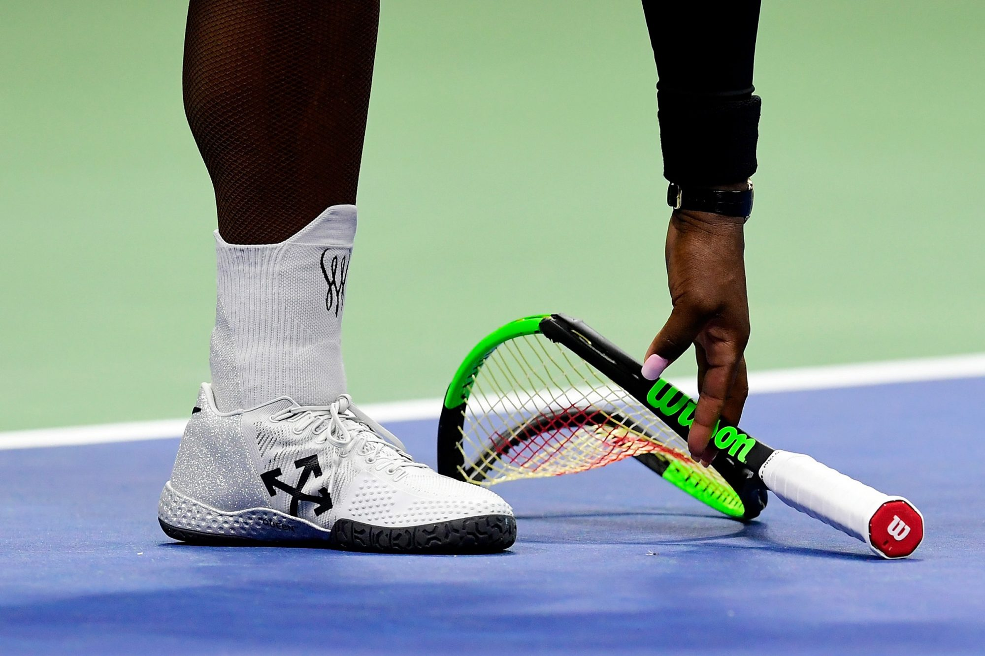 Serena Williams of the United States after smashing her racket during her Women's Singles finals match against Naomi Osaka of Japan on Day Thirteen of the 2018 US Open at the USTA Billie Jean King National Tennis Center on September 8, 2018 in the Flushing neighborhood of the Queens borough of New York City