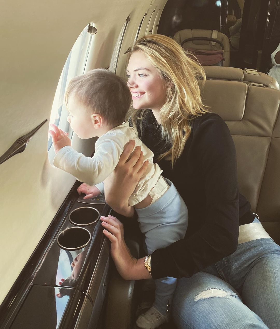 Kate Upton and her daughter on a private jet