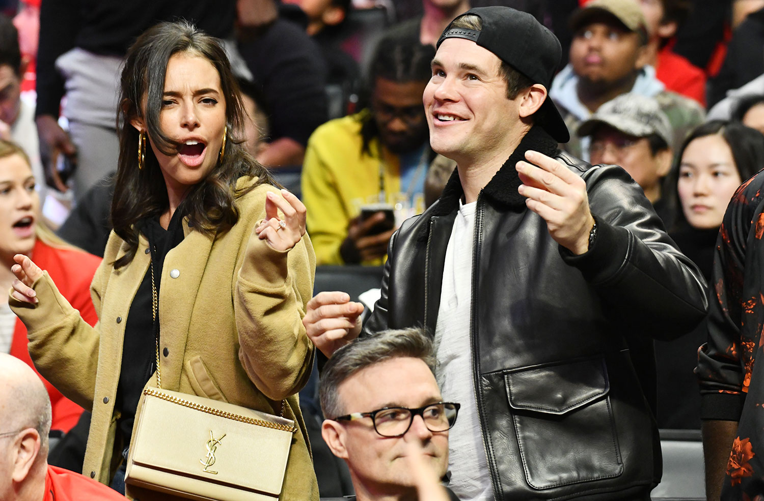 Chloe Bridges and Adam DeVine attend a basketball game between the Los Angeles Clippers and the Houston Rockets at Staples Center on December 19, 2019 in Los Angeles, California