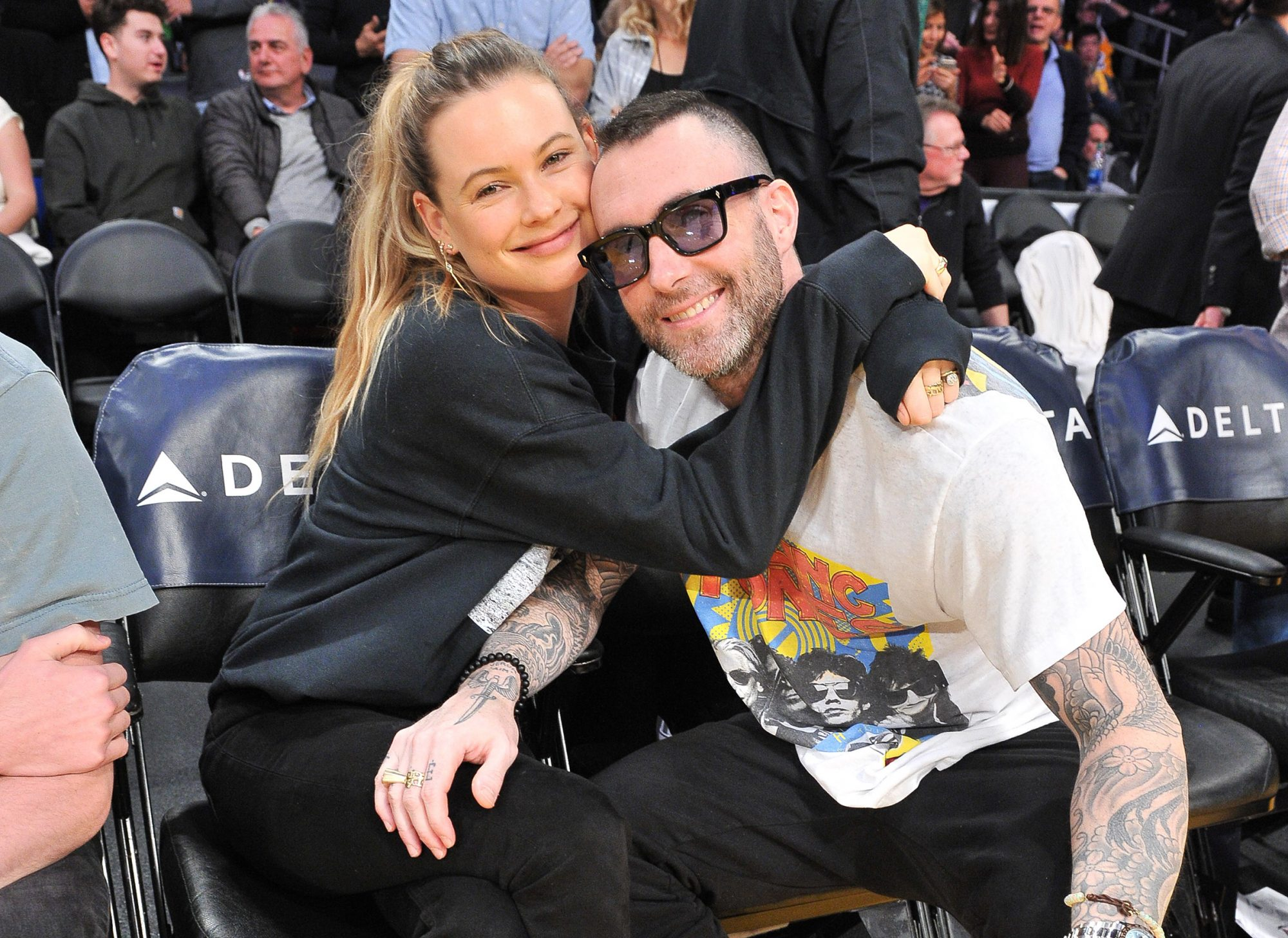 Adam Levine and Behati Prinsloo attend a basketball game between the Los Angeles Lakers and the Dallas Mavericks at Staples Center on December 01, 2019 in Los Angeles, California
