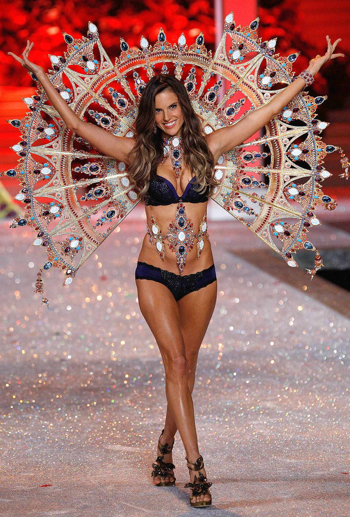 Model Alessandra Ambrosio walks the runway during the 2011 Victoria's Secret Fashion Show