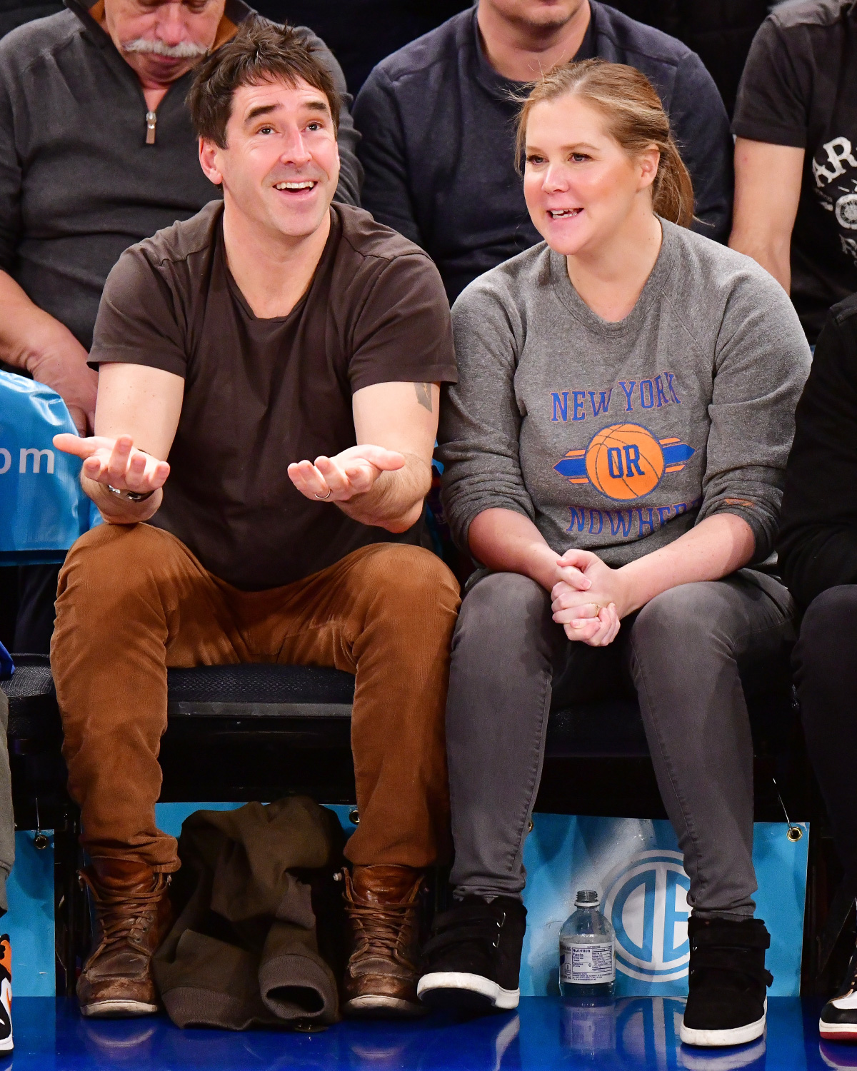 Chris Fischer and Amy Schumer attend Washington Wizards v New York Knicks game at Madison Square Garden on December 23, 2019 in New York City