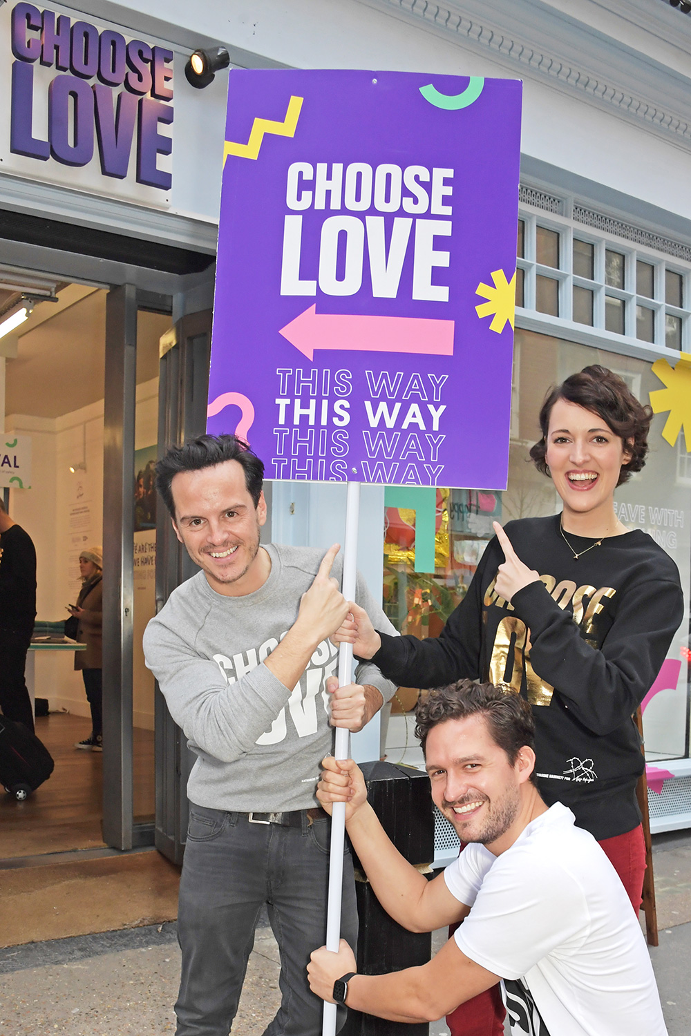 Andrew Scott, Ben Aldridge and Phoebe Waller-Bridge volunteer during Match Fund day at the 'Choose Love' shop for Help Refugees in Covent Garden on December 13, 2019 in London, England