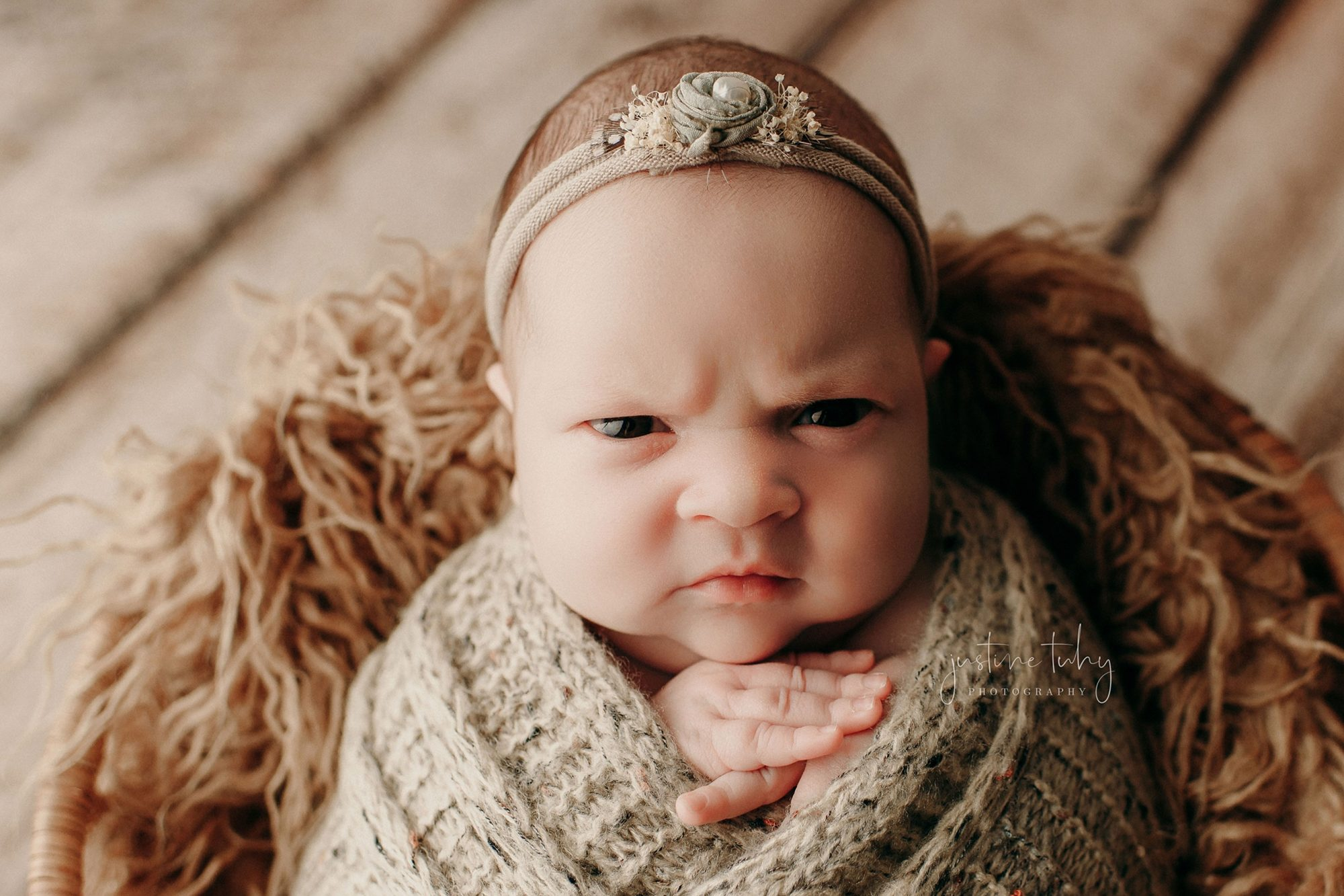 'Mean-Mugging' Baby Doesn't Seem Thrilled to Be Getting Her Photo Taken in Hilarious Photoshoot