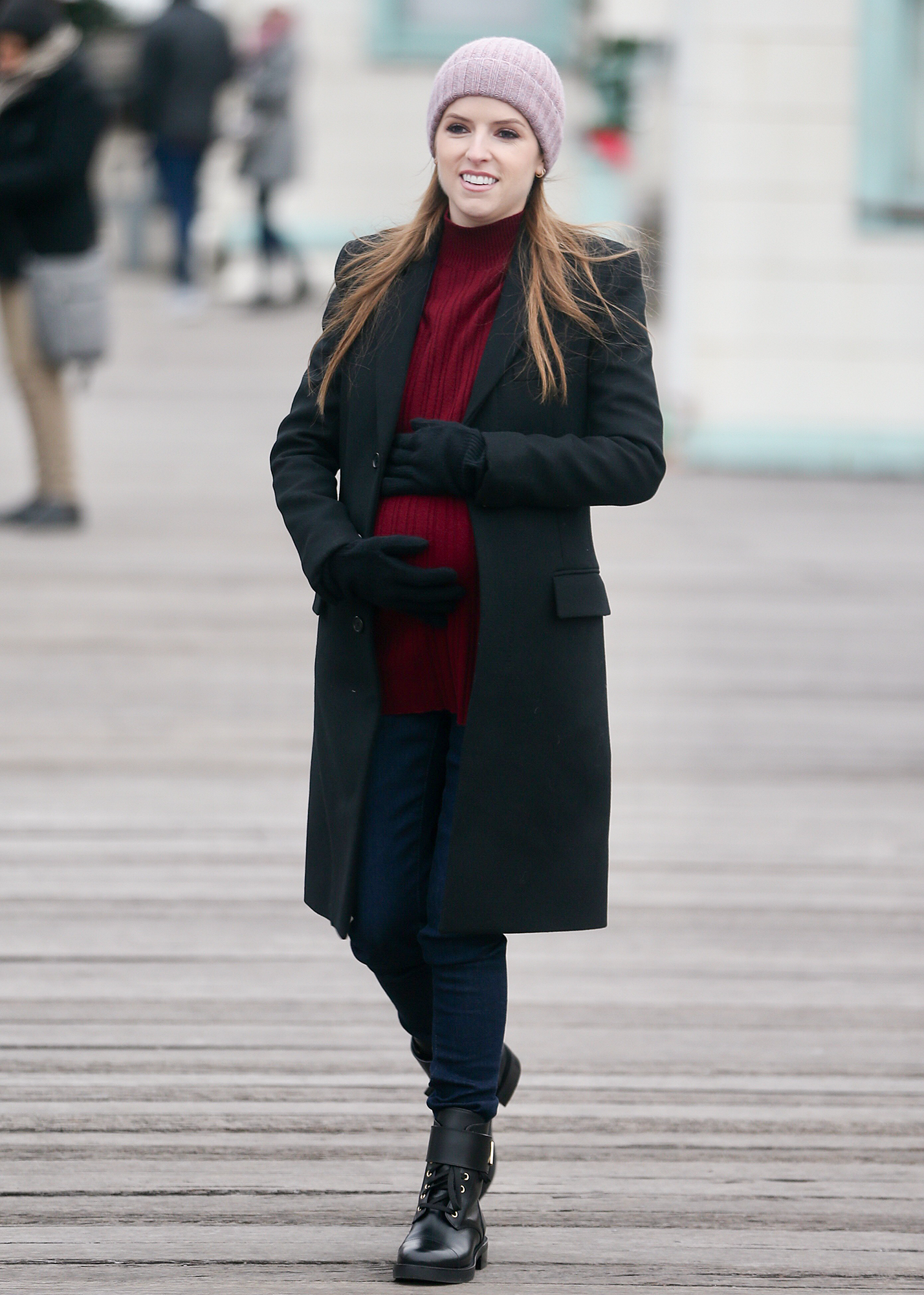 """Anna Kendrick holds a baby bump as she shoots a scene for the HBO' series, """"Love Life"""" in Brooklyn this morning. 16 Dec 2019"""