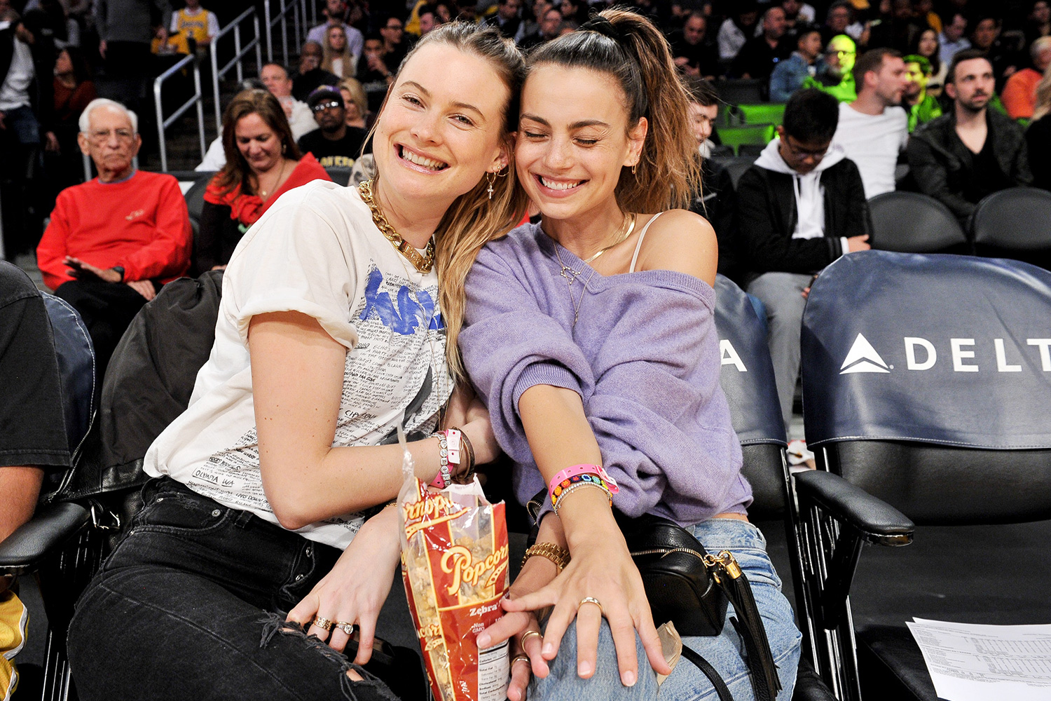 Behati Prinsloo (L) and Whitney Hartley Wagner attend a basketball game between the Los Angeles Lakers and the Denver Nuggets at Staples Center on December 22, 2019 in Los Angeles, California