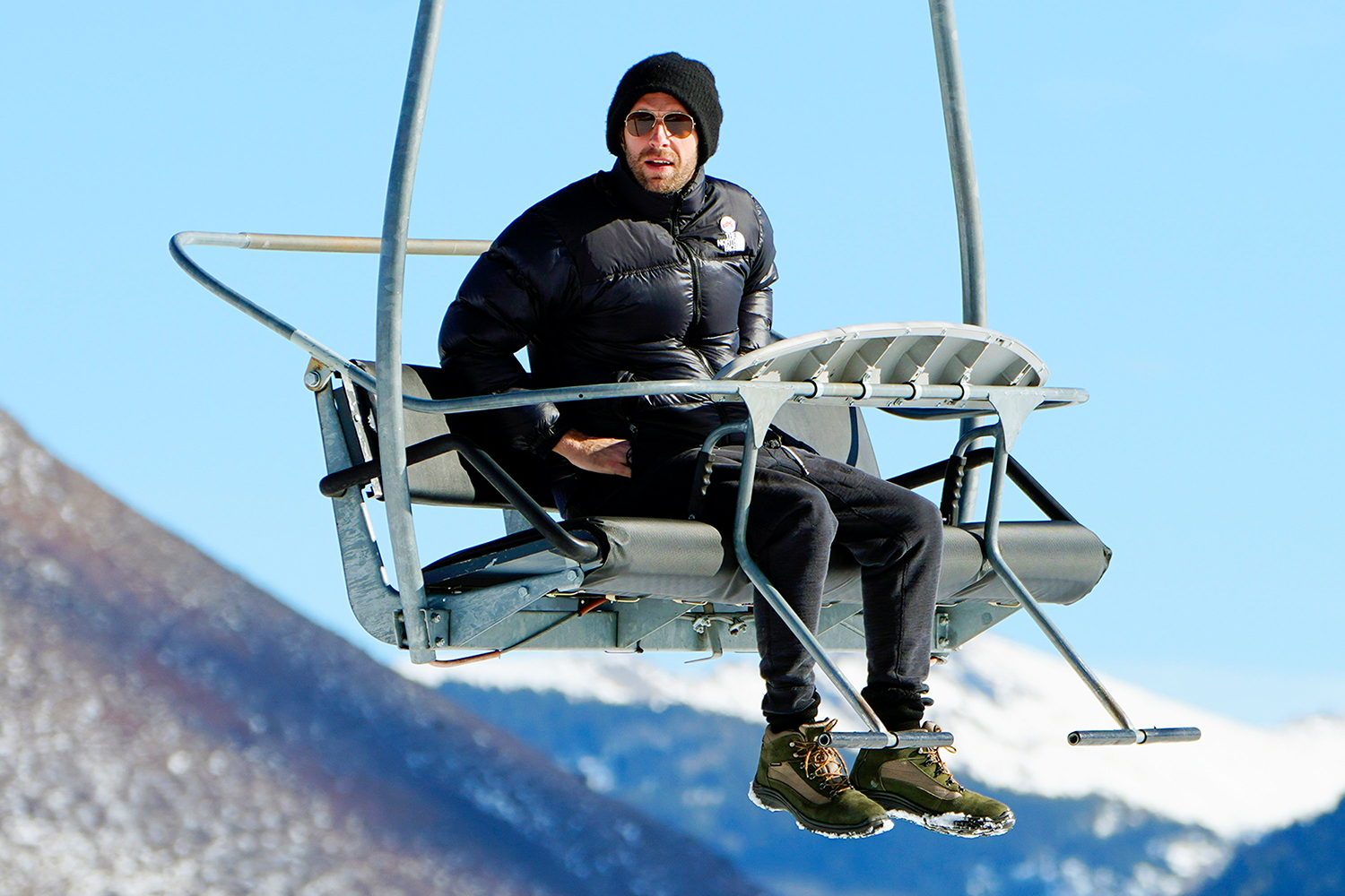 Chris Martin takes a solo trip up a ski lift for some sight seeing in Aspen Colorado