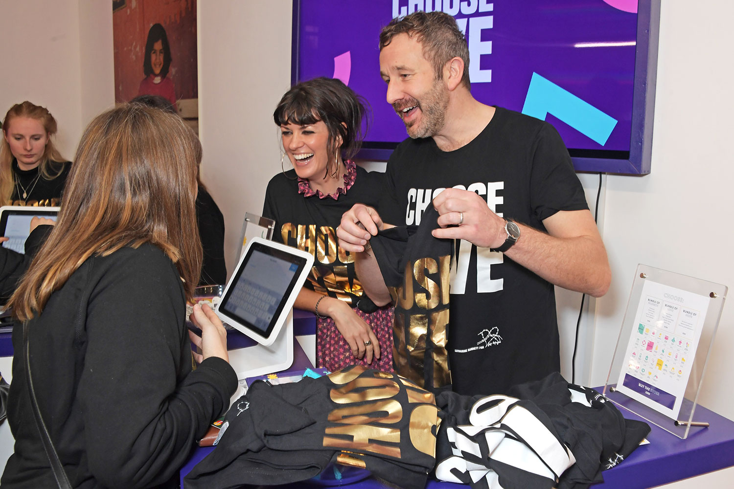 Dawn O'Porter and Chris O'Dowd volunteer at the 'Choose Love' shop for Help Refugees in Covent Garden on December 19, 2019 in London, England