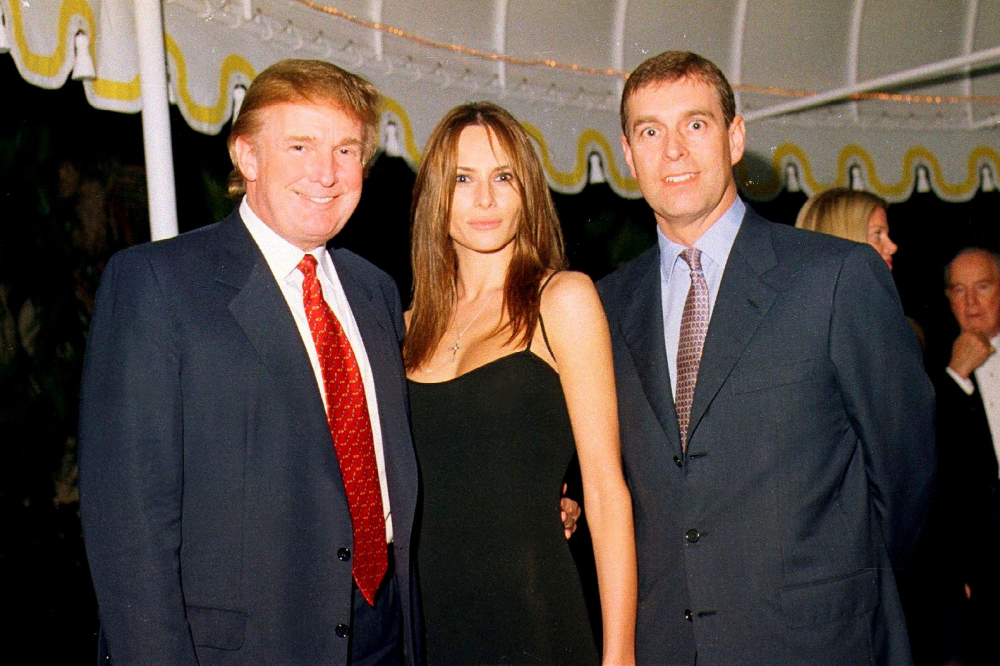 Donald Trump, his girlfriend (and future wife), former model Melania Knauss, and British Prince Andrew, Duke of York, as they pose together at the Mar-a-Lago estate, Palm Beach, Florida, February 12, 2000
