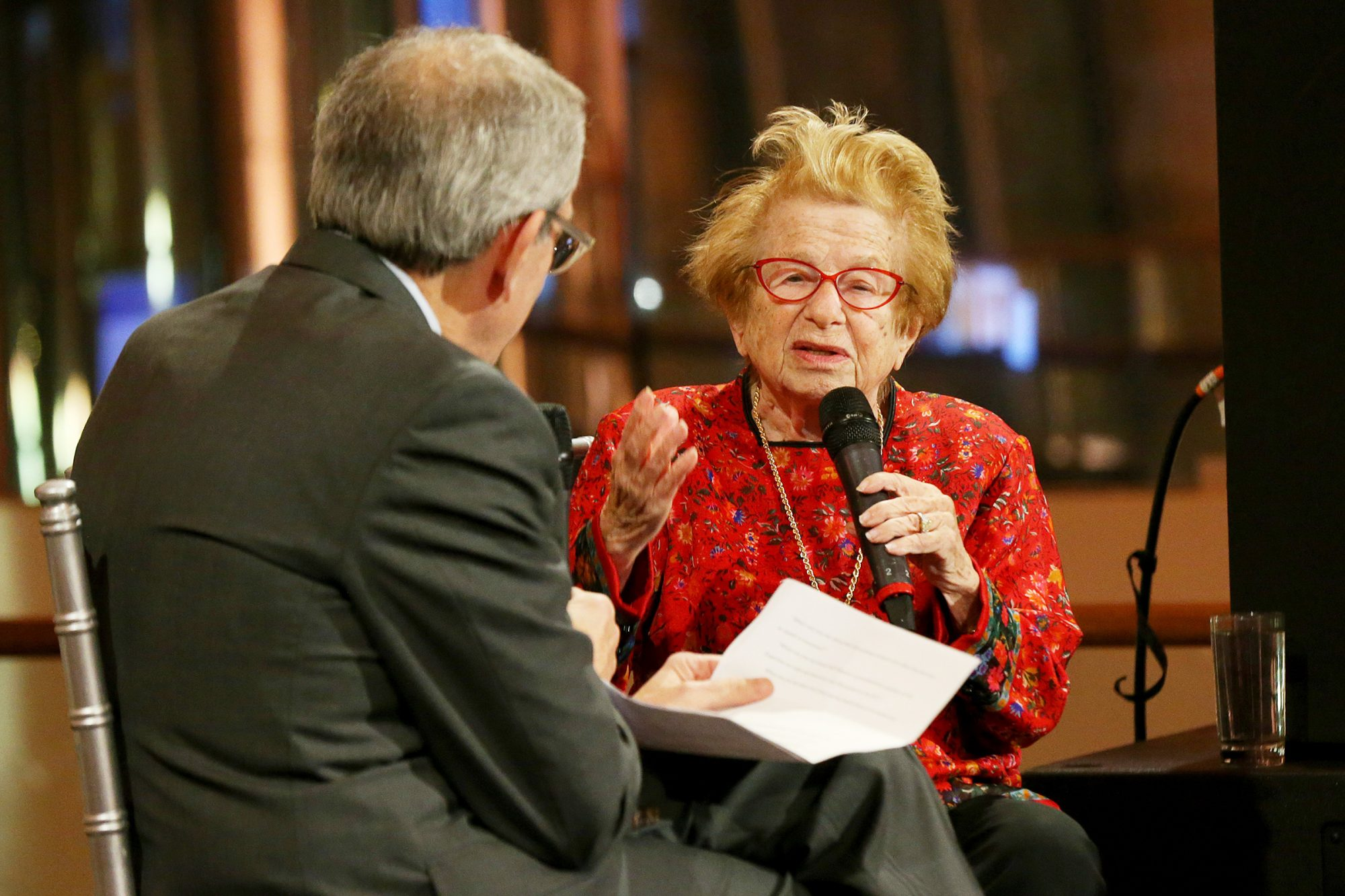 David Marwell interviews Dr. Ruth on stage during the YM&YWHA Of Washington Heights And Inwood Gala Honoring Dr. Ruth at Gustavino's on December 03, 2019 in New York