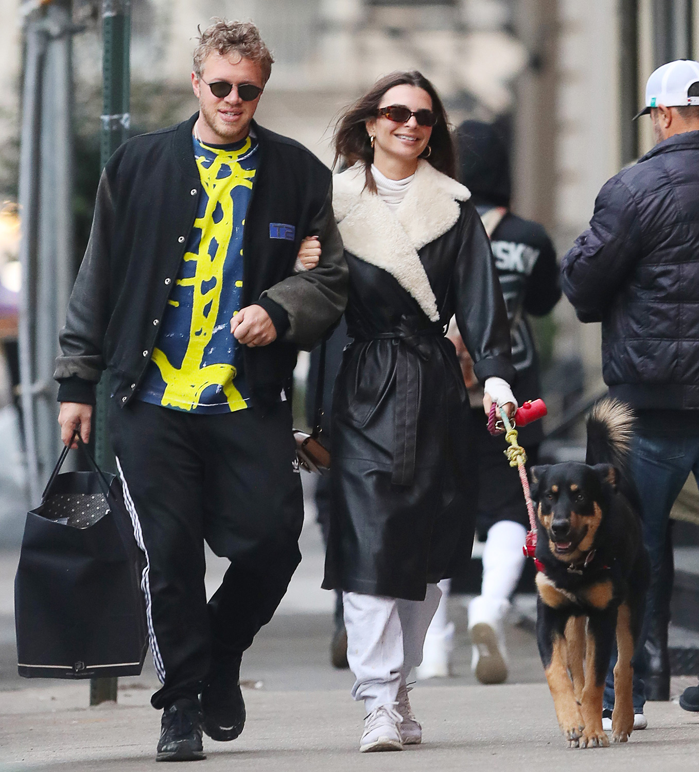 Emily Ratajkowski and Sebastian Bear-McClard are spotted out walking their dog in downtown Manhattan