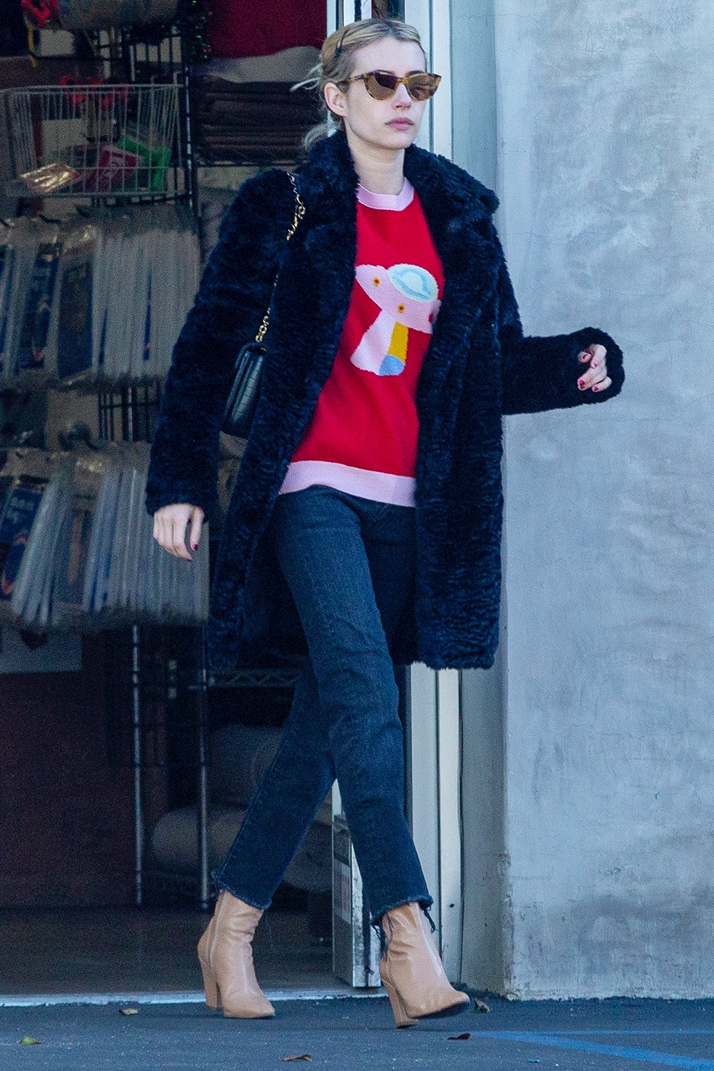 Emma Roberts stops at a store to ship some gifts on Christmas Eve while out running errands in Los Feliz.