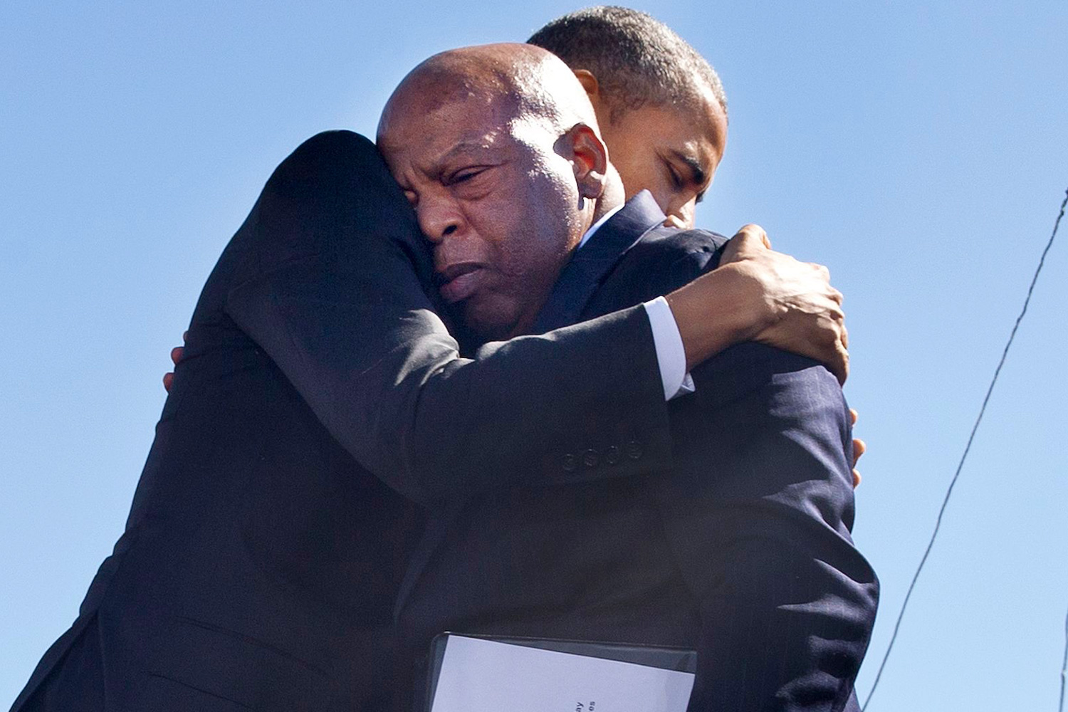 "Barack Obama embraces Rep. John Lewis, D-Ga., after Lewis introduced the president with an emotional speech by the Edmund Pettus Bridge in Selma, Ala., on the 50th anniversary of ""Bloody Sunday,"" a landmark event of the civil rights movement, . Rep. Lewis was beaten during ""Bloody Sunday"" and is a leader of the civil rights movement Obama Selma 50th, Selma, USA"
