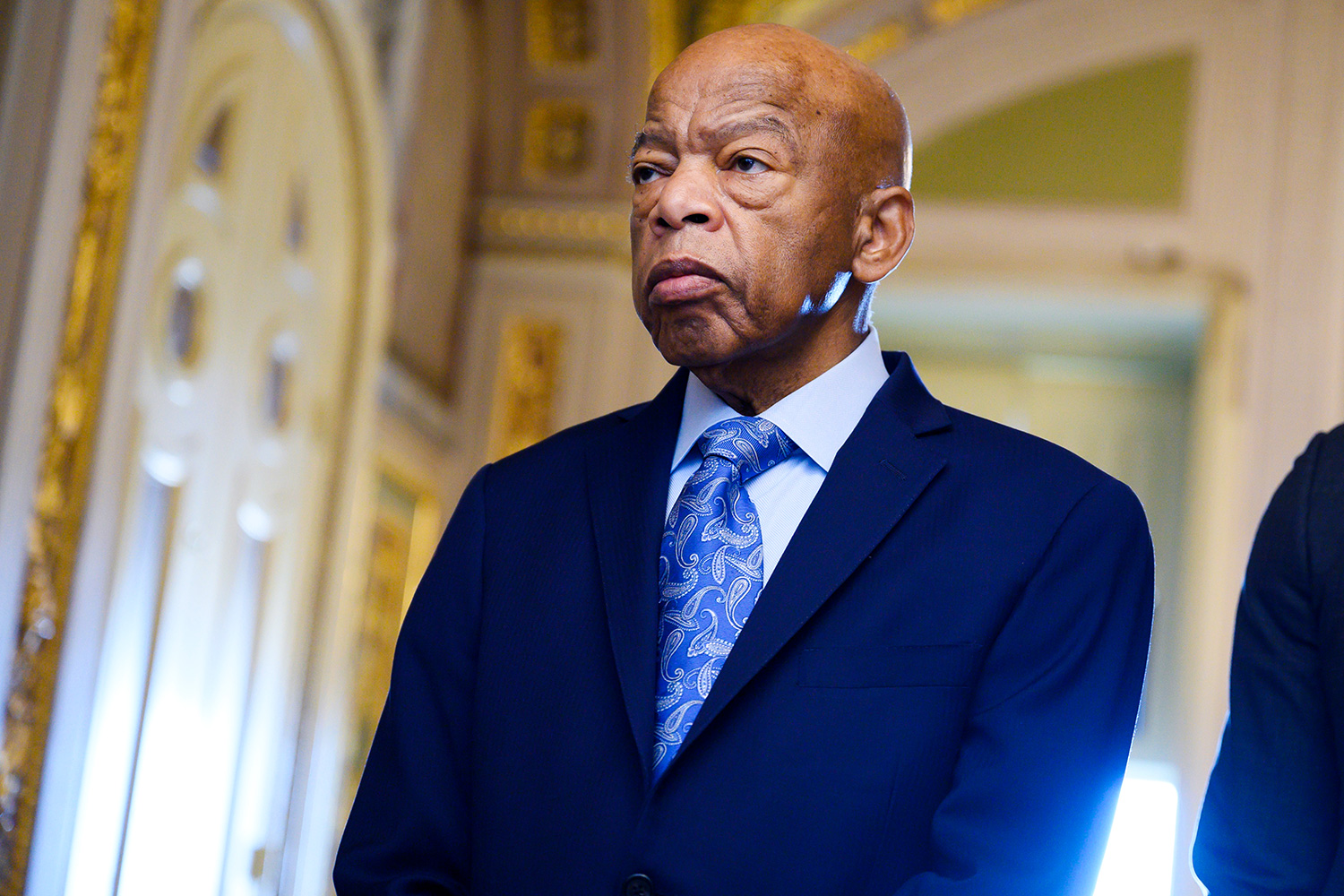Rep. John Lewis, D-Ga., waits to enter the Senate chamber to listen to the farewell address of the Sen. Johnny Isakson, R-Ga., in the Capitol on Tuesday, December 3, 2019