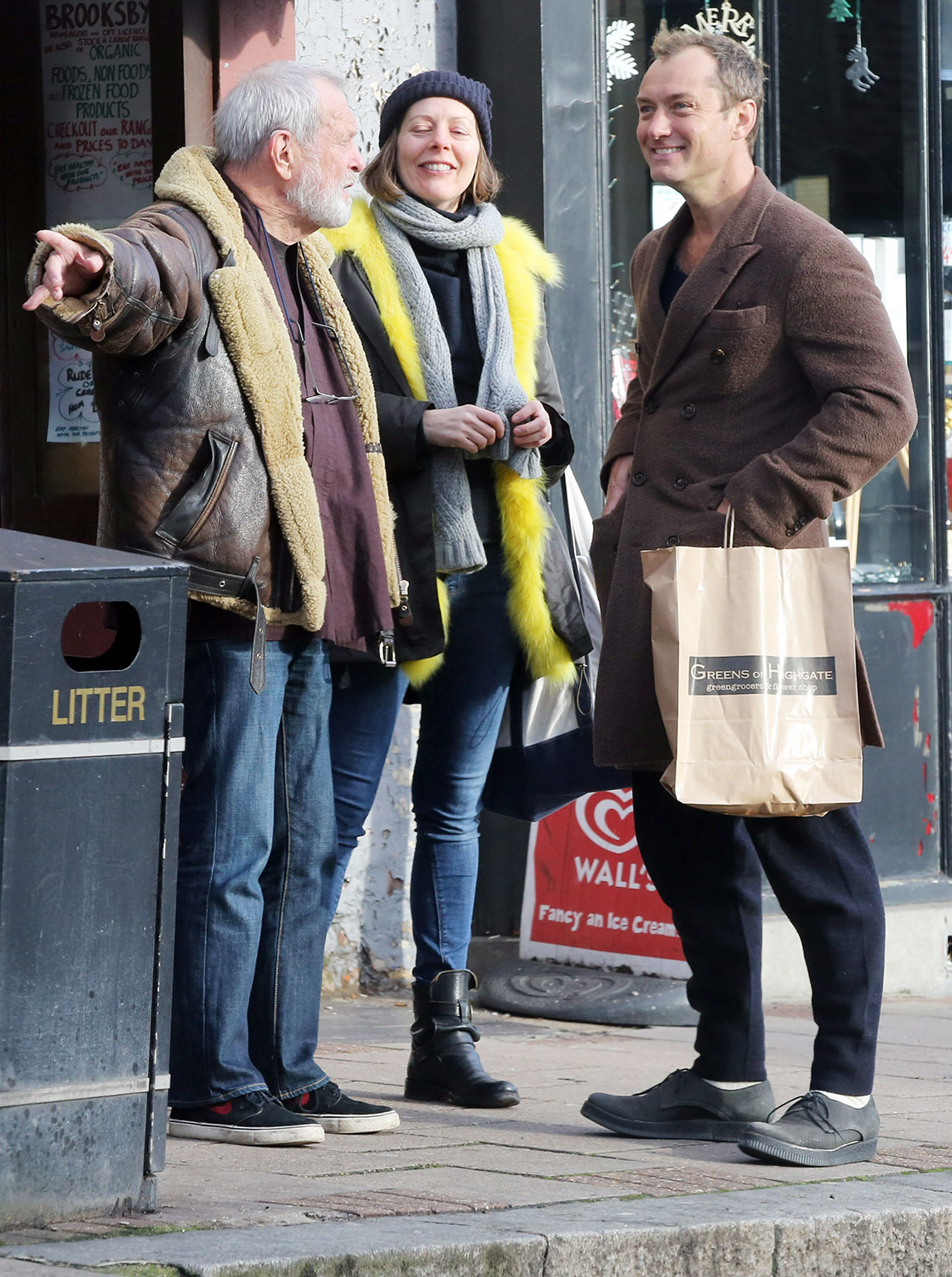 Jude Law embraces Terry Gilliam as he runs into the director in North London