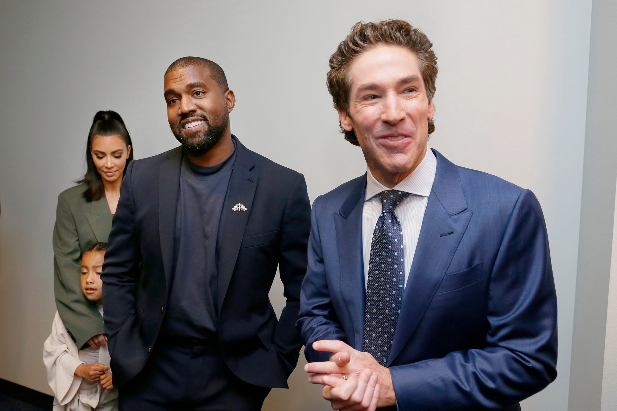 From left, Kim Kardashian West, North West, Kanye West and Sr. Pastor Joel Osteen answers media question after the 11 am service at Lakewood Church, in Houston Lakewood Church's 11am service, Houston, USA - 17 Nov 2019