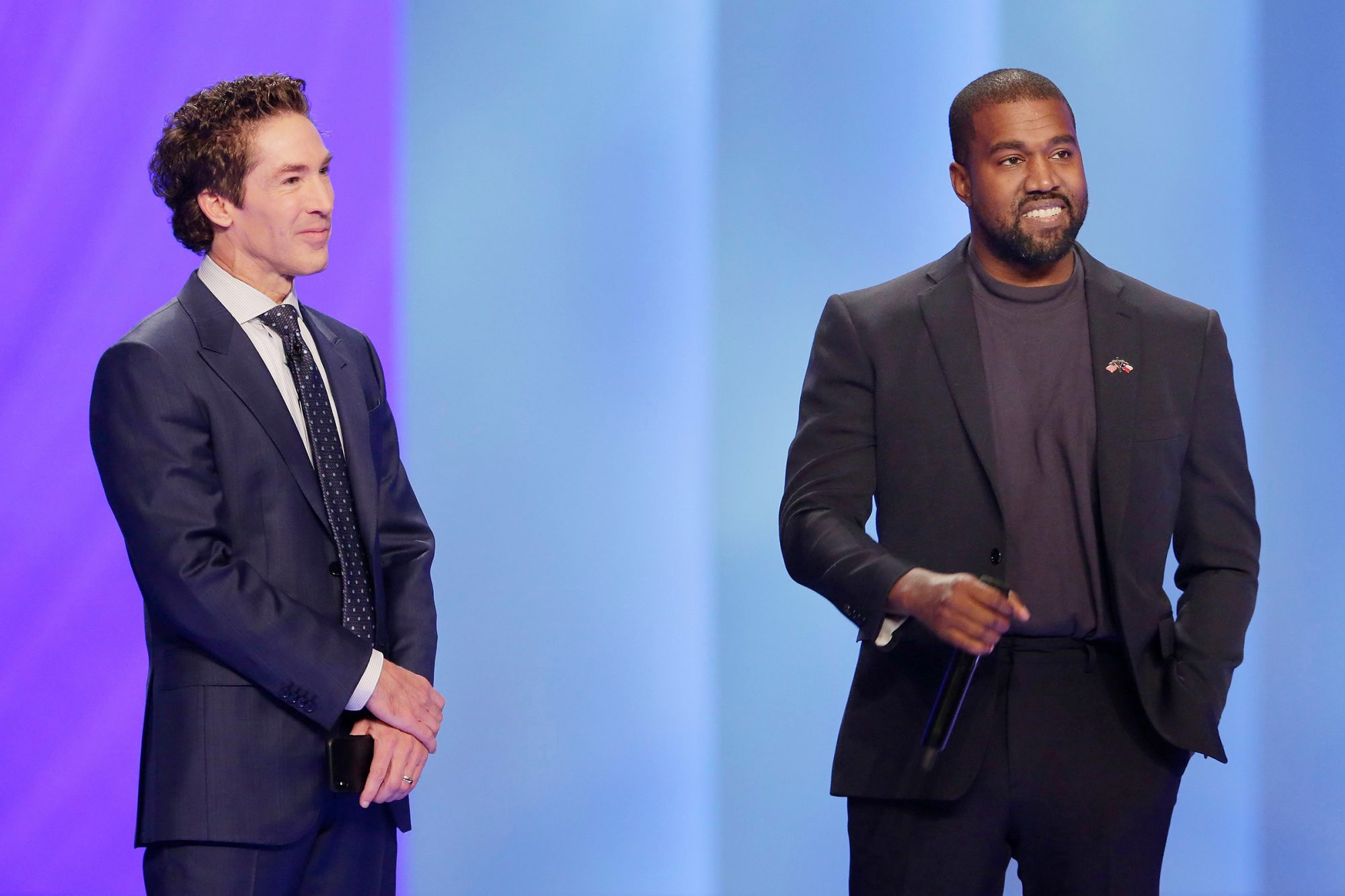 Kanye West, left, answers questions from Sr. pastor Joel Osteen, right, during the 11 am service at Lakewood Church, in Houston Lakewood Church's 11am service, Houston, USA - 17 Nov 2019