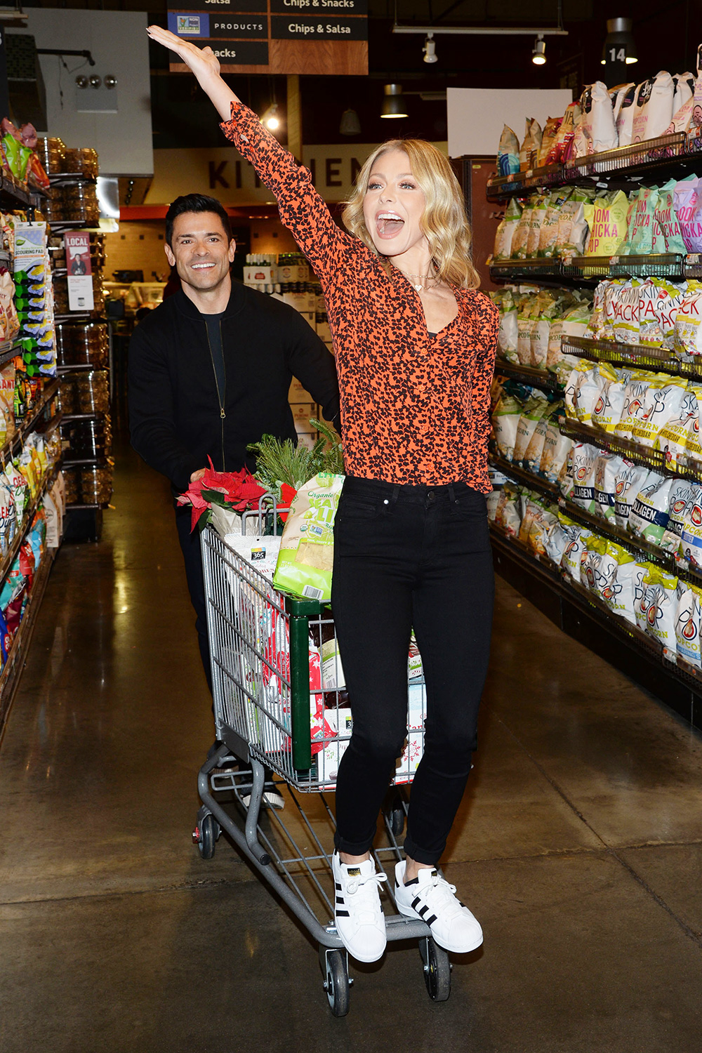 Kelly Ripa and Mark Consuelos join Amazon in Delivering Smiles this holiday season at Whole Foods Market.