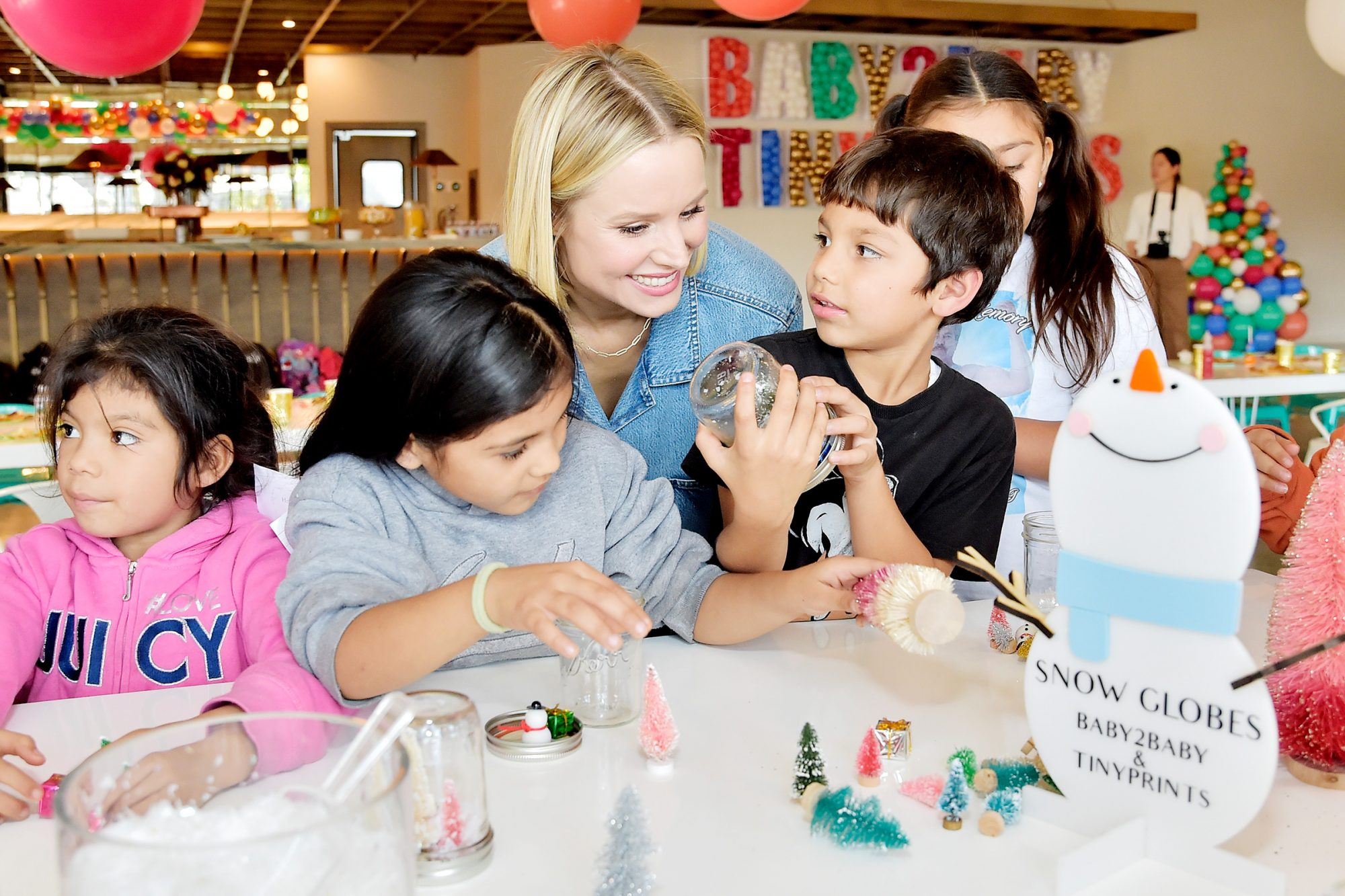 Kristen Bell Hosts The Baby2Baby And Tiny Prints Winter Wonderland at Casita Hollywood on December 05, 2019 in Los Angeles, California
