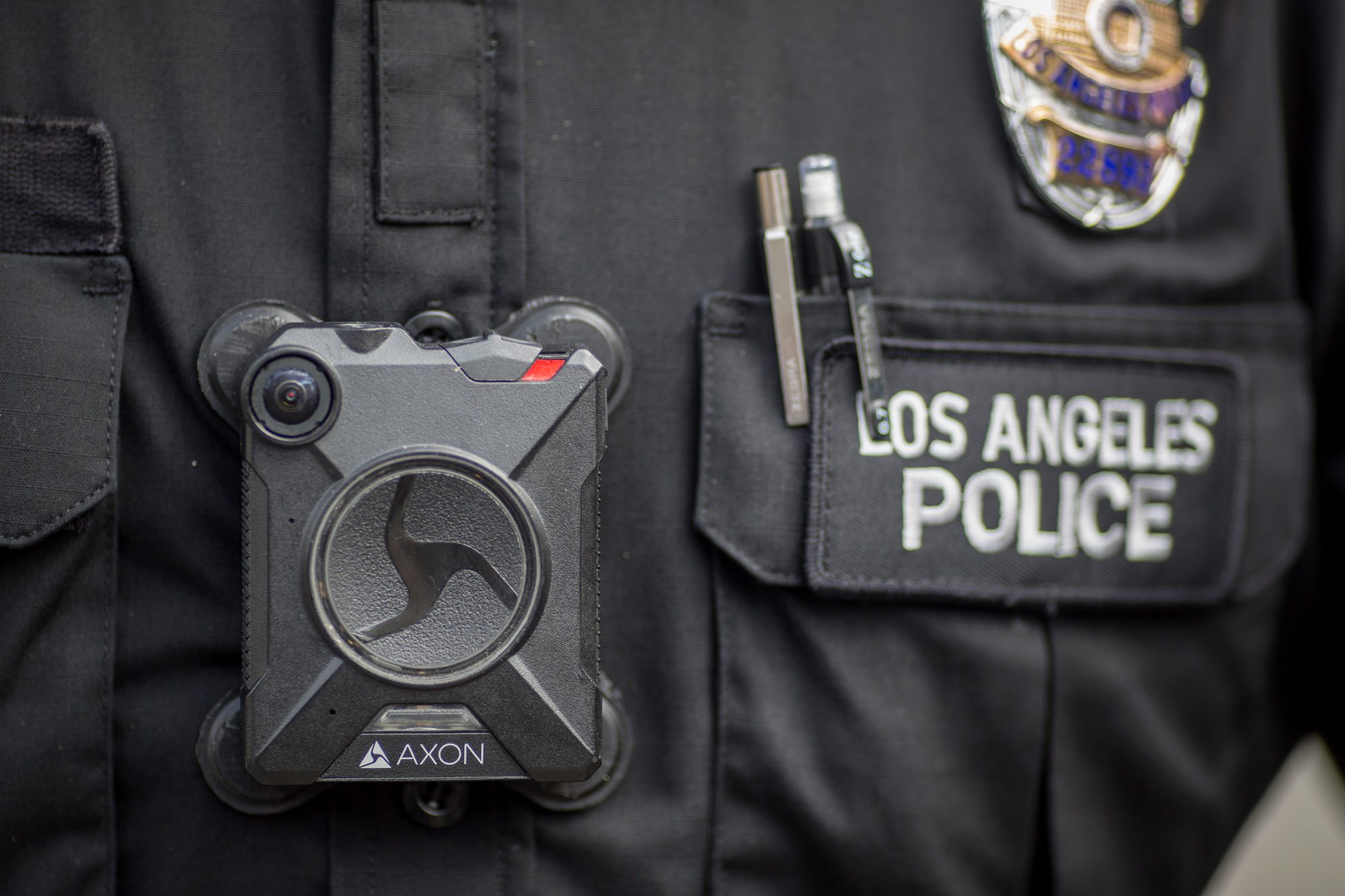 A Los Angeles police officer wear an AXON body camera during the Immigrants Make America Great March to protest actions being taken by the Trump administration on February 18, 2017 in Los Angeles, California. Protesters are calling for an end to stepped up ICE raids and deportations, and that health care be provided for documented and undocumented people.