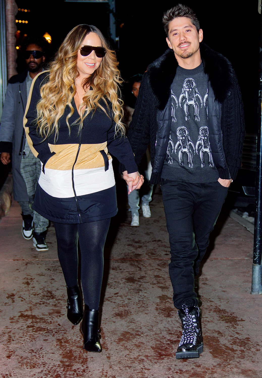 Mariah Carey and Brian Tanaka are all smiles when navigating the slippery streets of Aspen, CO while going from store to store