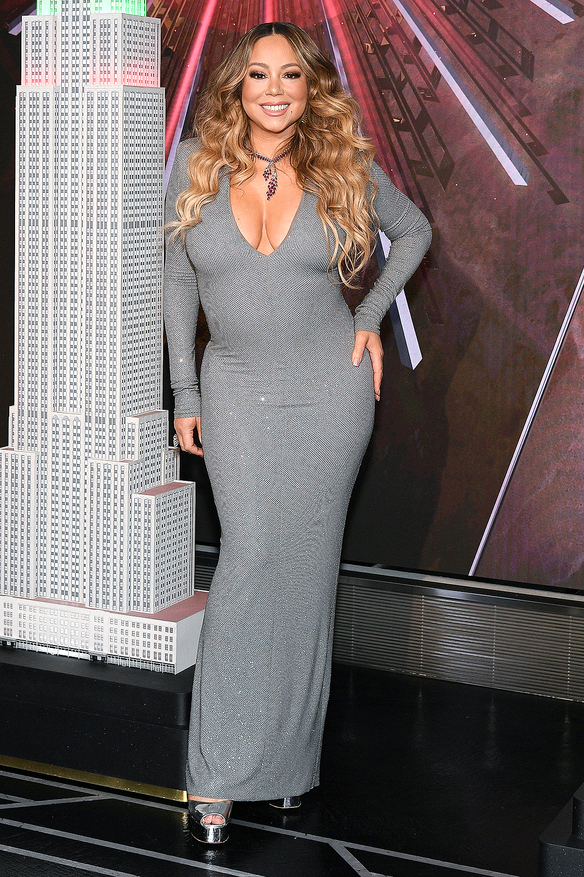 """NEW YORK, NEW YORK - DECEMBER 17: Mariah Carey lights the Empire State Building in celebration of the 25th anniversary of """"All I Want For Christmas Is You"""" at the Empire State Building on December 17, 2019 in New York City."""