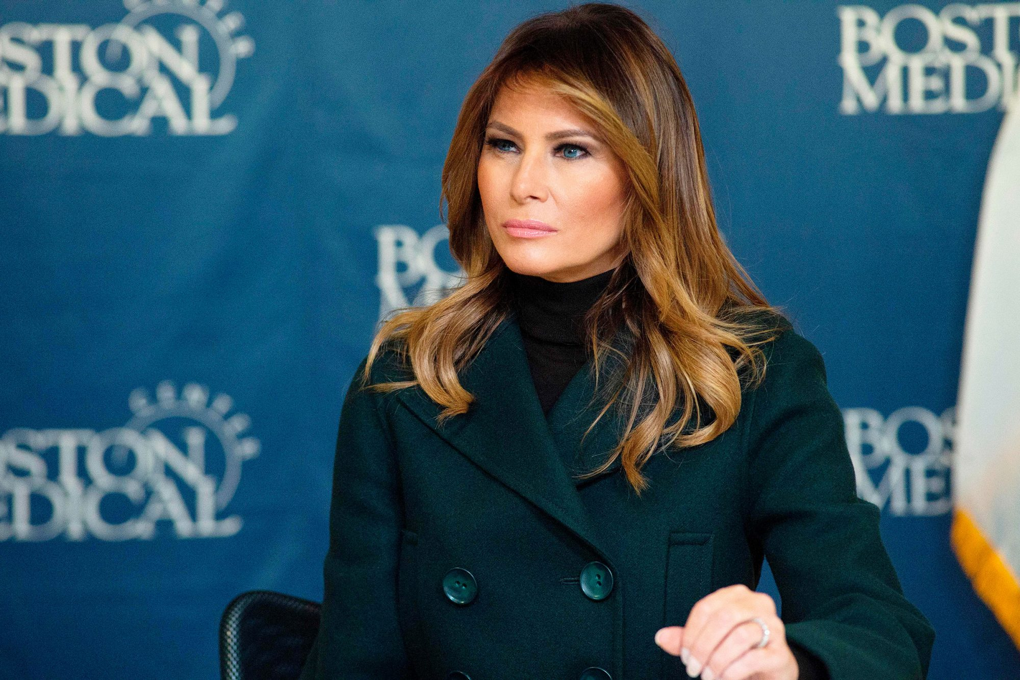 Melania Trump sits and listens to doctors during a round table and visit to Boston Medical Center