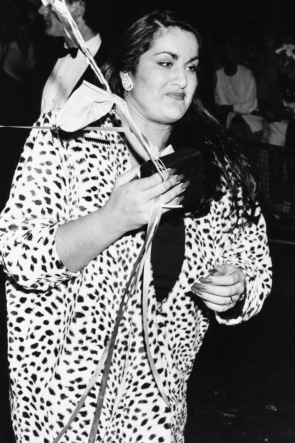Melanie Panayiotou, sister of singer George Michael, holding balloons as she attends the 'Wham!' farewell party, London, July 8th 1986
